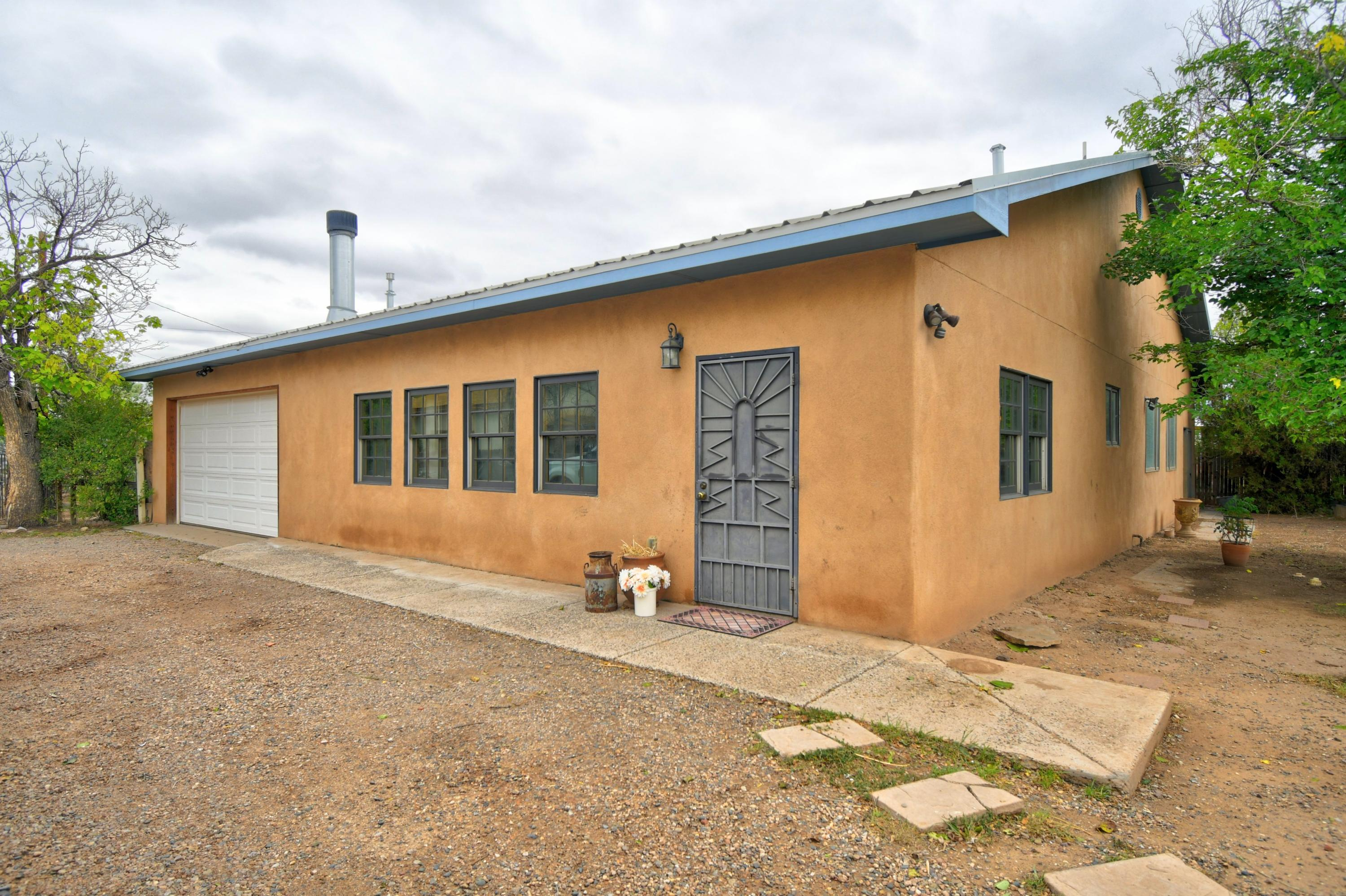 This is a must see if you are looking for an amazing multigenerational home on a quiet street in the North Valley with a fenced 1/2 acre lot! The house has 3 or 4 bedrooms and the updated casita has 2 or 3 additional bedrooms with a total of 4 bathrooms. Both home and casita have refrigerated air, light and bright open floorplans that are perfect for a growing family. The casita was completed updated 11 years ago and includes granite countertops, soft close drawers, gas stove, Saltillo tile, hand plastered walls and latilla ceiling. The main house has hardwood floors, and a beautiful wood burning fireplace in the family room. The updated kitchen in the house has a huge walk in pantry and lovely formal dining room, ideal for the chef in the family.