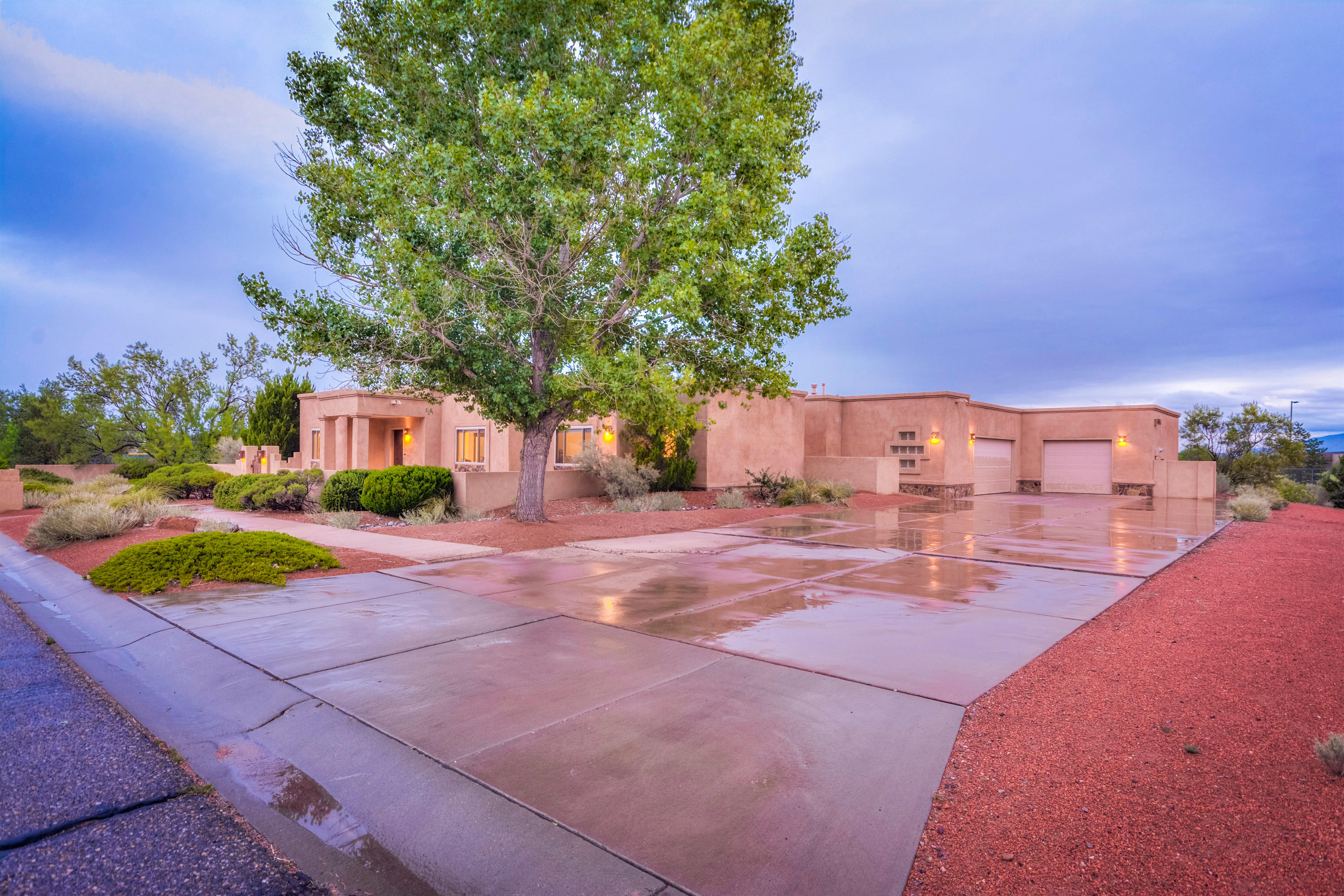 This great custom home has so much space to spread out and enjoy your own private oasis!  Located on close to an acre, there is room to add more to the backyard if you desire.  4 beds and 3 full baths plus two living spaces or two dining spaces.  The front room could also be enclosed as an office if desired.  This house has great storage with 2 pantries, and a huge 3 car+ garage with workshop and more storage.  The home has central vac plus garage vacuum system.  The property features native vegetation with no homes behind or to the North of the property.  The covered patio is amazing for entertaining.  Also includes a basketball court.  This property has so much to offer and in a great neighborhood.  Enjoy private land with public utilities and sewer, but still close to everything!