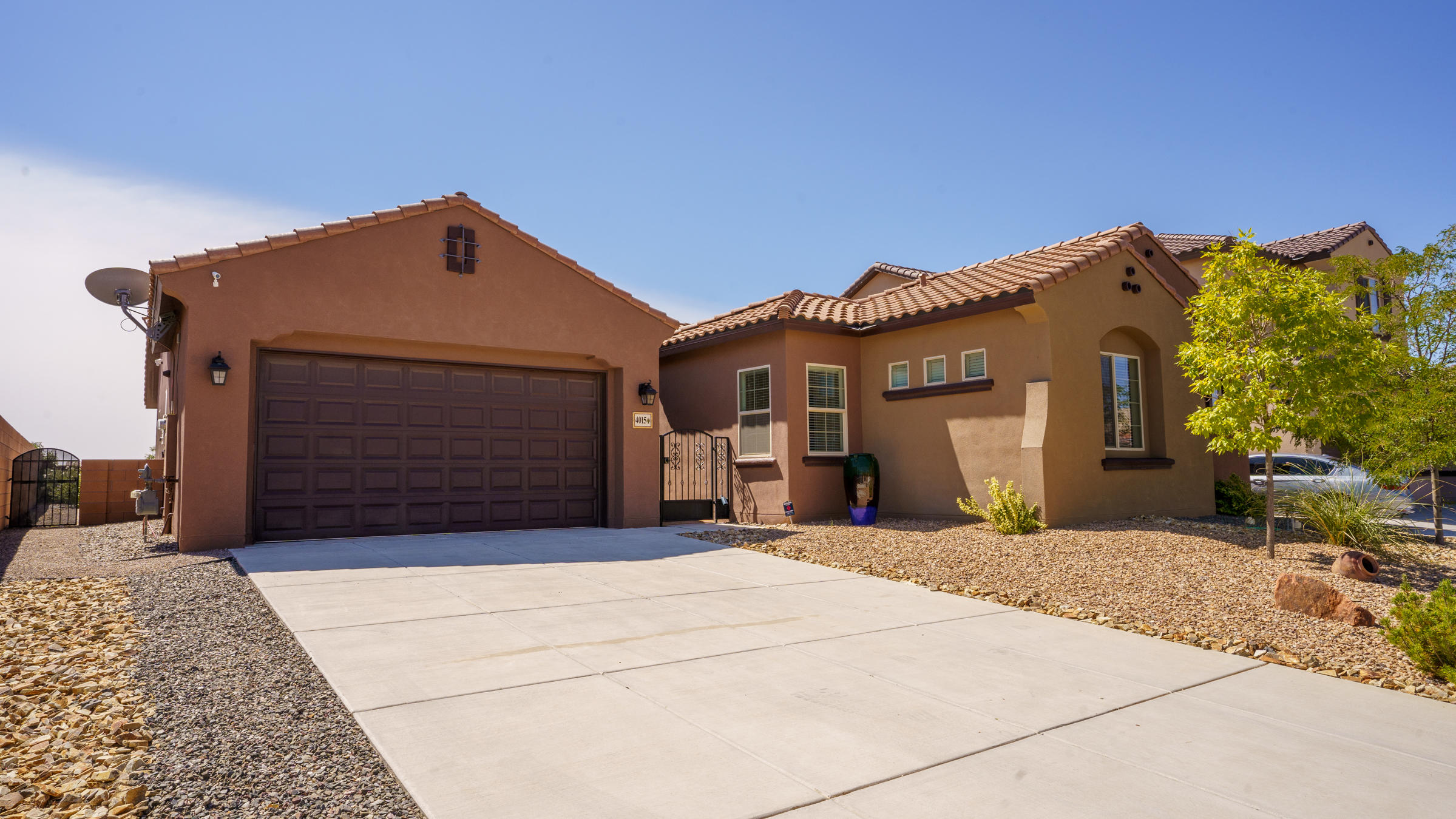 Pristine one story home that has owned solar panels make this a must see! This spacious 4 bedroom home offers a second master with an adjoining living room, open floor plan , large open kitchen that looks out to the main living room and dining room - perfect for entertaining! A beautiful landscaped yard with Sandia mountain views could be yours!Come by and see it today!