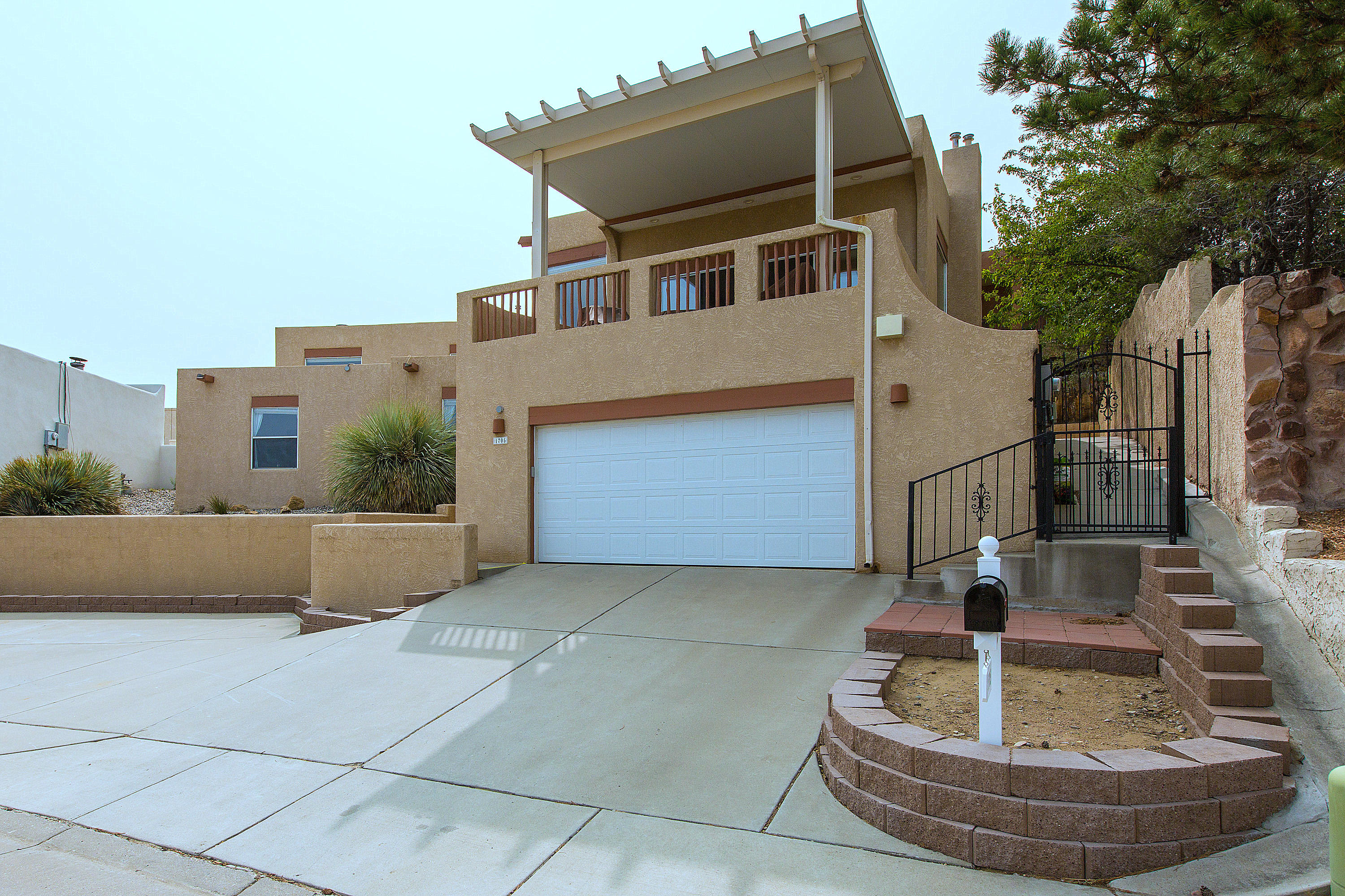 Amazing Views from this custom home located in an upscale established neighborhood. Centrally located with easy access to I-40, shopping, eats and more. 180 degree views of the Rio Grande Valley, Downtown, Sandias, Manzanos, Old Town, Bio Park & the Bosque. Downstairs wing is separate, private, quiet & offers 2 BR's & BA.  Upstairs boasts open living area w/expansive views, spacious deck, kitchen w/lots of storage, formal DR, & second large living space w/gas kiva + another BR, BA & the Primary Suite where you'll find a large BR, MORE VIEWS, gas kiva fireplace, bath w/dual sinks, separate tub & shower, huge walk-in closet w/ built-in storage. Natural light thru out this home! Relax in your safe, private pocket of long-term residents perched on the Bluffs of the Rio Grande.