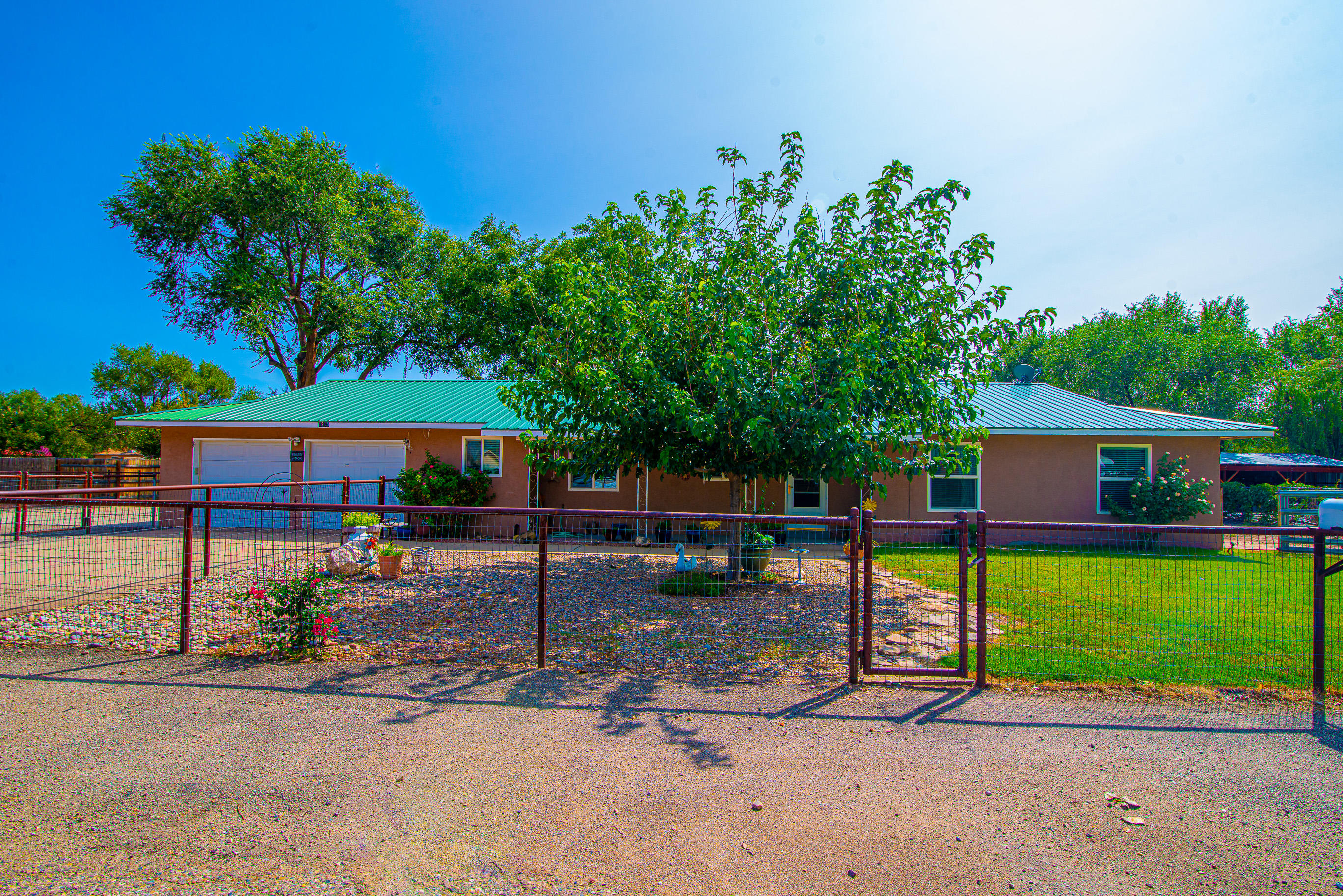 Well maintained home on 1/2 acre in a quiet yet convenient location w/quick access to the park, library, multi-use paths, community center, tennis courts and rodeo arena. This Bosque Farms beauty features 3 bedrooms/3 bathrooms, large family room with wood burning insert, refrigerated air, large pantry, laundry room and mud room with half bathroom.  Oversized garage can accommodate full sized truck, beautifully landscaped front and back w/backyard access, irrigation well with sprinklers and a storage building w/carport for all your extra toys. The covered patio is private and perfect for relaxing. Pipe rail area in the back for your four legged friends or garden.  Bosque Farms offers an exceptional elementary school. Come take a look...you'll want to move in!