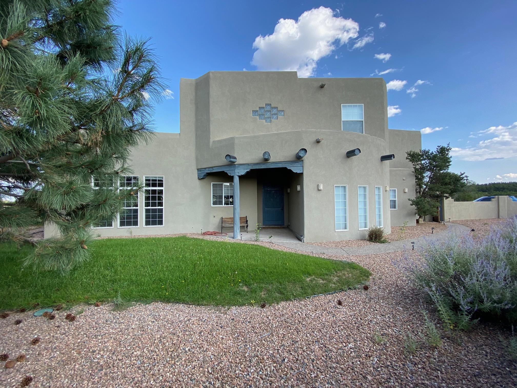 Move in right away!  Custom pueblo style home, on almost 3 acres, Fenced, landscaped backyard., large shade trees. Great location, right off of NM 217. Moriarty schools, Kiva fireplace for those winter evenings, plus a pellet stove, radiant floors. Small private subdivision, must see!
