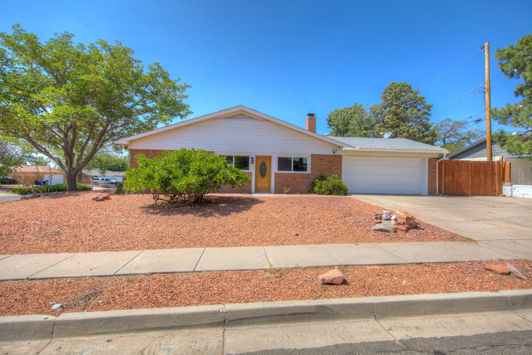 Welcome to your new home. New laminate flooring throughout the home. The kitchen has been remodeled with new counter tops , cabinetry, and appliances. Oversized corner lot with backyard access. The garage is larger with a small workshop for those weekend DIY  projects.