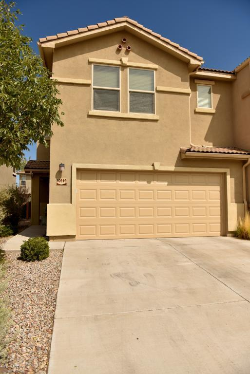Newly updated 2 bed/2.5 bath, 1725 sqft townhome in the gated Presidio community, minutes from Kirtland AFB, Sandia Labs, restaurants, and hiking/biking trails! New paint and new carpet make this home move-in ready. The large master bedroom features a walk-in closet, separate tub and shower, and private bathroom. The spacious second bedroom also features a walk-in closet and detached large bathroom with a shower/tub combo. Two living spaces and a low-maintenance, fully landscaped backyard with drip irrigation make entertaining easy. A gourmet kitchen with granite countertops, ample cabinet space, and a roomy pantry overlooks the open floorplan of the main living and dining spaces. Complete with a 2-car garage with a new opener, and all appliances (including W/D) stay with the home!