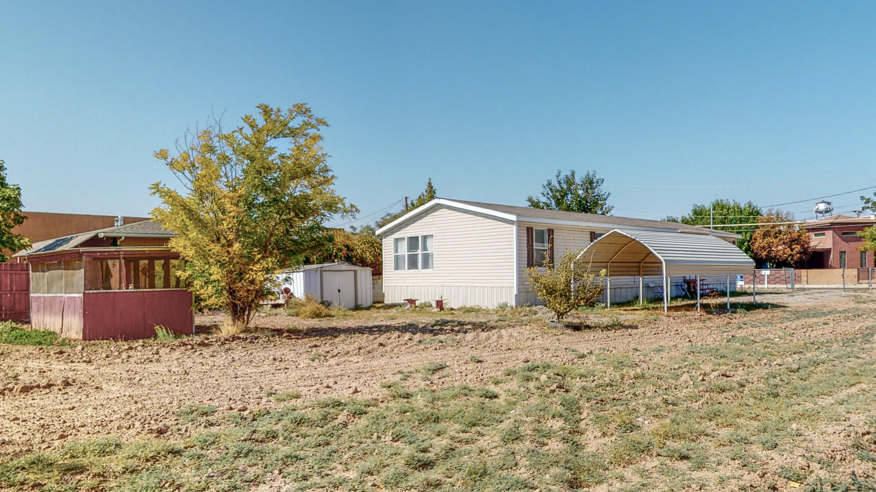 .40 Acres! Backyard Access! Grapes! Apple Tree! Carport! Garden Tub! Bonus Room/2nd Living Area! All appliances convey! See attached documents! Professional photos coming soon!