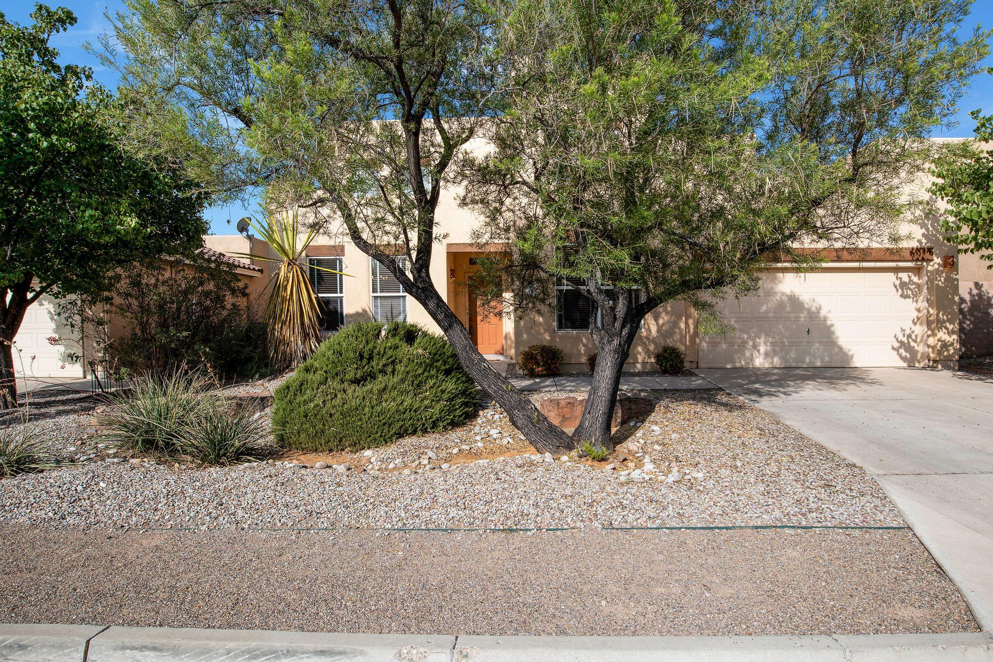 Welcome home to this beauty in the desirable Cottonwood Trails gated community! Great location with close access to shopping, bike and walking trails, and easy access to Paseo del Norte. This meticulously maintained 4/5 bedroom home offers a main floor master suite, formal dining room, and large office/family/game/5th bed room. Soaring tall ceilings with elongated windows and kiva fireplace are featured in the spacious living room. The kitchen offers dual ovens, cooktop stove, and ample counter space. Large Master Suite with a walk-in closet, master bath w/double sinks, garden tub and a stand alone shower. Cozy, enclosed back porch leads to the landscaped backyard complete with putting green! This one will not last long! Virtual and Video tours available!