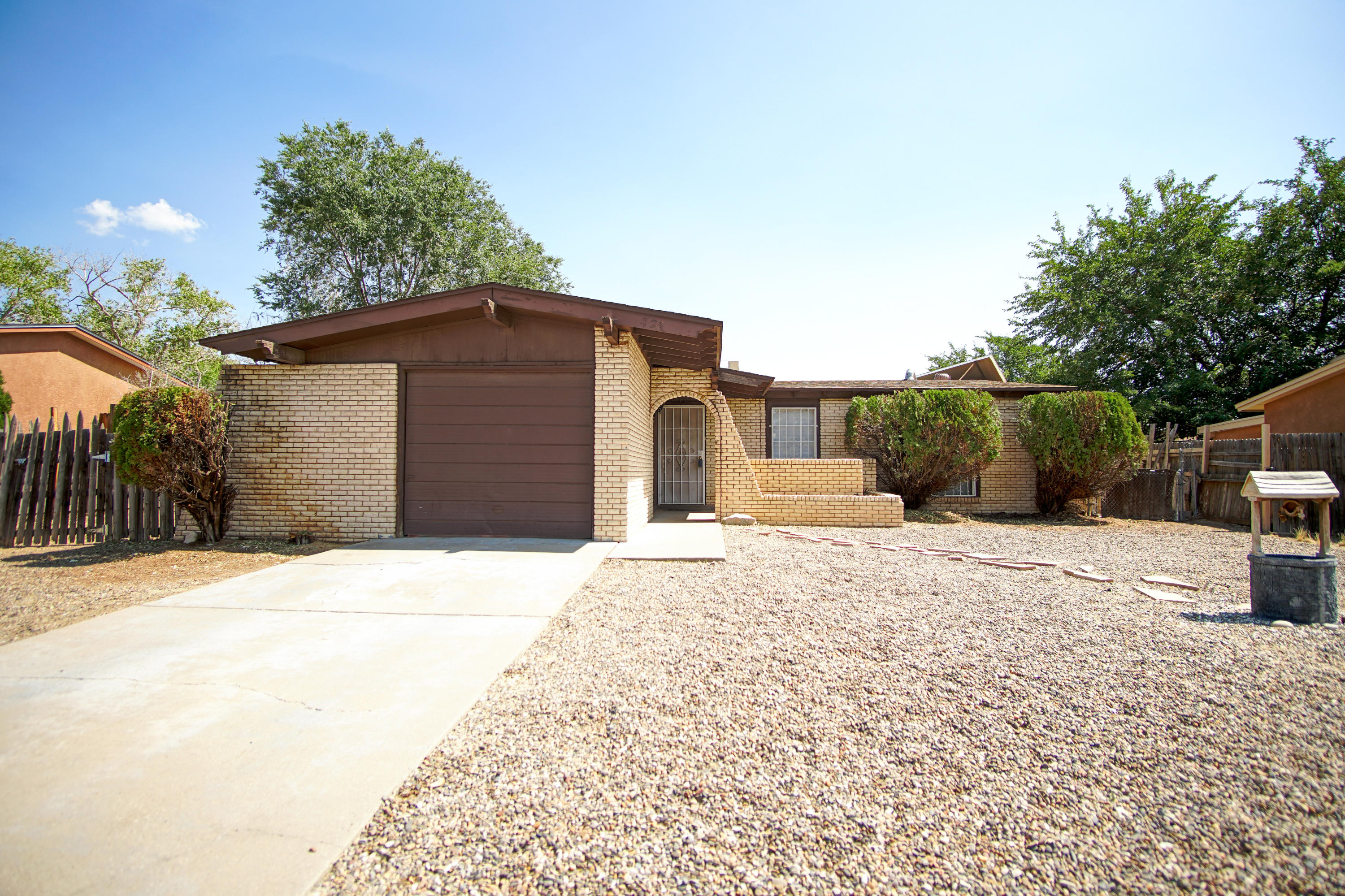 Great find in the NE Heights. Ranch style home in quiet neighborhood close to Juan Tabo and I-40 access. This 3 bed, 2 bath home has a great layout that features flexible living and dining areas that surround the kitchen. Unique space for an office/study. All appliances convey - washer & dryer too! There is an oversized one car garage with plenty of storage. The lot has backyard access with plenty of side yard space. Fresh paint throughout makes this home move in ready!