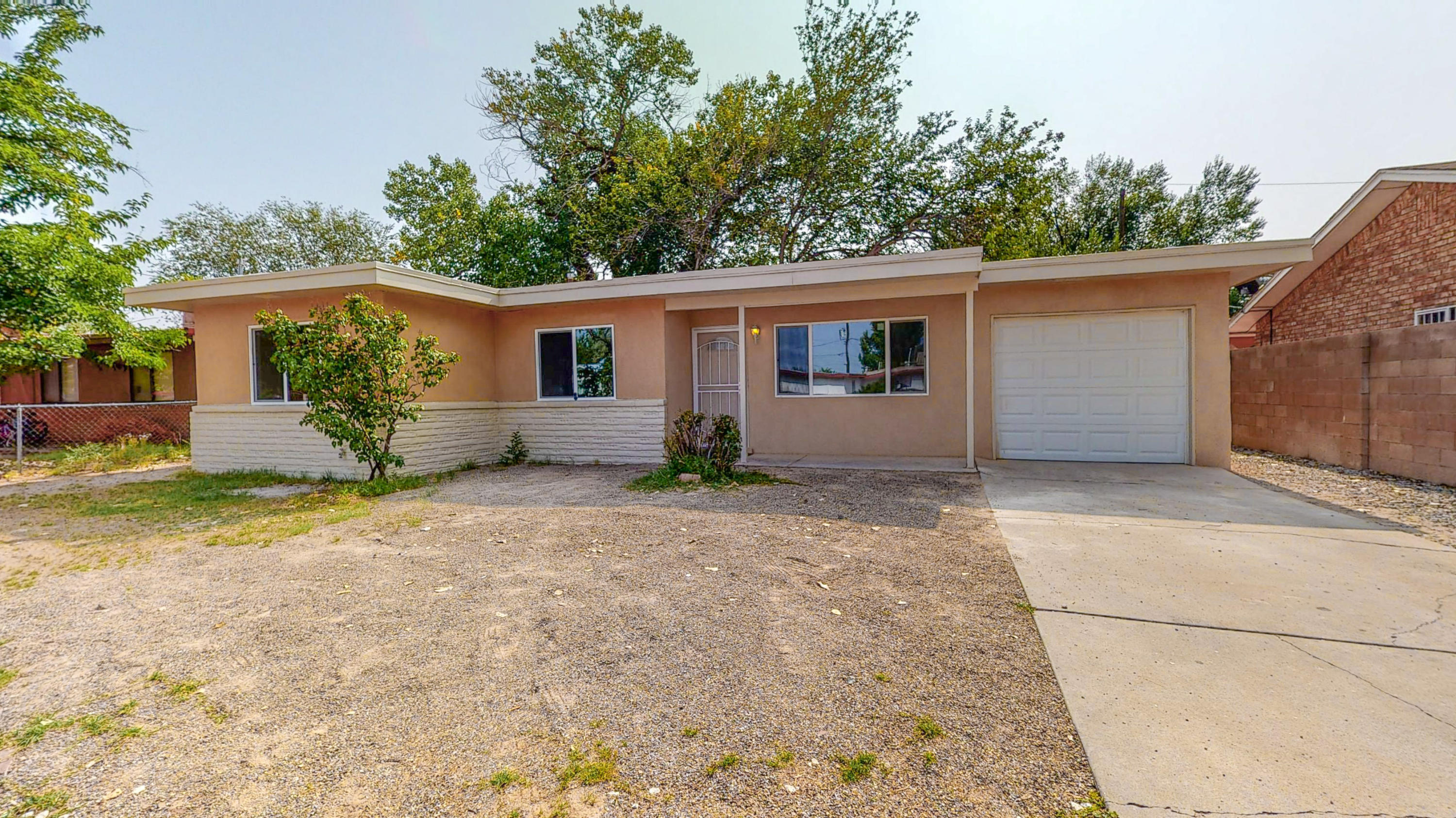 This 4 bed, 2 bath South Valley home features NEW! New Roof! New Stucco! New Windows! New Bathrooms! New Refrigerated Air! New Heater! New Water Heater! New Appliances! New Garage Door! I could go on! Come see it for yourself today! This could be your NEW Home!