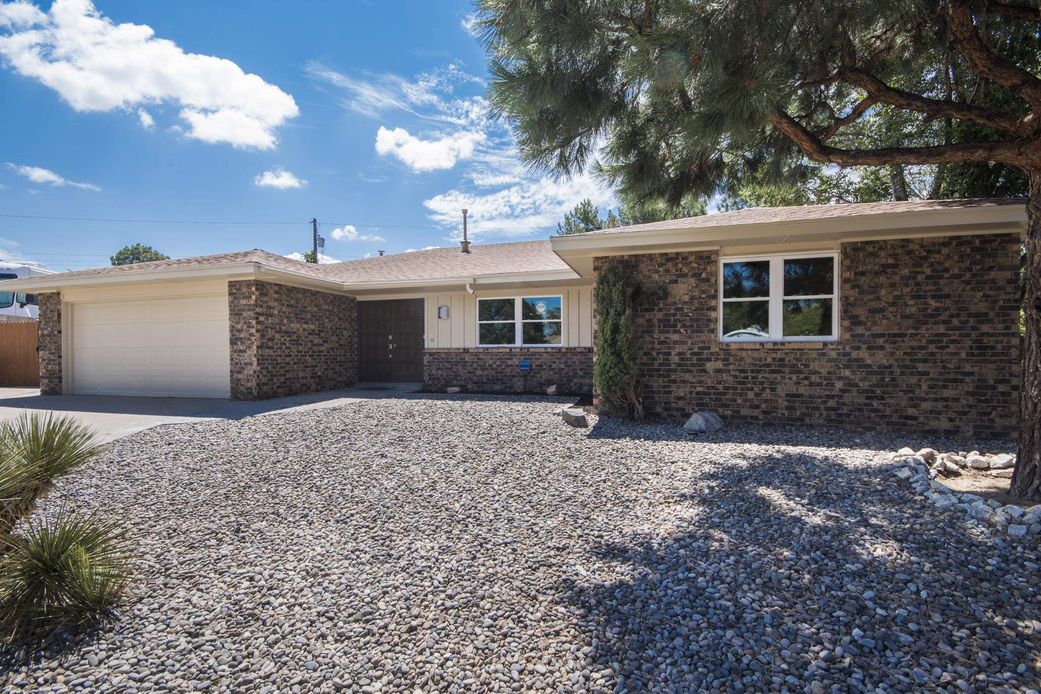 Lovely ranch home in NE ABQ. Hard-Floor surfacing throughout. Beautifully remodeled kitchen featuring mocha cabinets, quartz counter tops, and SS appliances. Fully remodeled bathrooms in 2018 with custom tile, new cabinetry and all fixtures. Newer lighting, fixtures, hardware, fresh paint 2018. Newer Roof! Open and diverse floor plan w/ spacious rooms throughout. 3+ Living areas. 1 w/ custom bar area w/ wine-refrigerator and another perfectly setup for home office, HOME SCHOOLING, or what ever...  Lounge/office area in Master was a 4th Bedroom and can easily be converted back to a 4th bedroom.