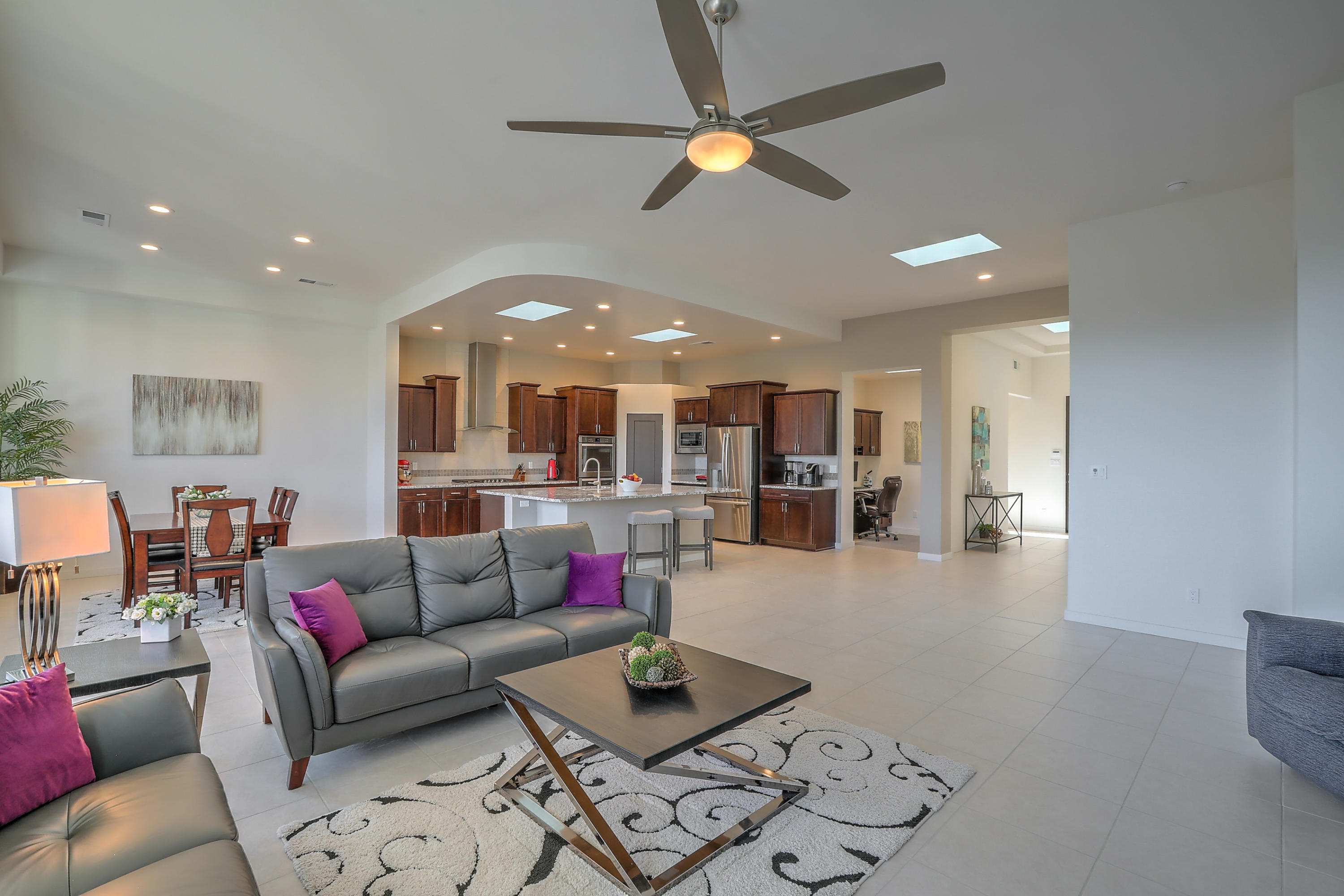 Practically brand-new contemporary Home located in a Gated Community in 87122, North Star, Desert Ridge & La Cueva districts! Seller relocating January so there is time to get yours sold or simply plan for a fresh start in 2021! You will love the open, light filled home, raised ceilings, clean lines & Chic architectural finishes - ceiling treatments, custom lighting, granite throughout & sleek tiled backsplash. Separated owner's suite, large rooms, 2 walk-in closets, full baths w/double sinks, spacious living/kitchen - great for entertaining, living/dining combo w/cozy fireplace & a perfect tucked in study w/built in desk, cabinetry & counterspace! Private, easy-care yards relax by the firepit, evergreen turf lawn & expansive covered patio, it's everything you want in your ABQ Dream Home!