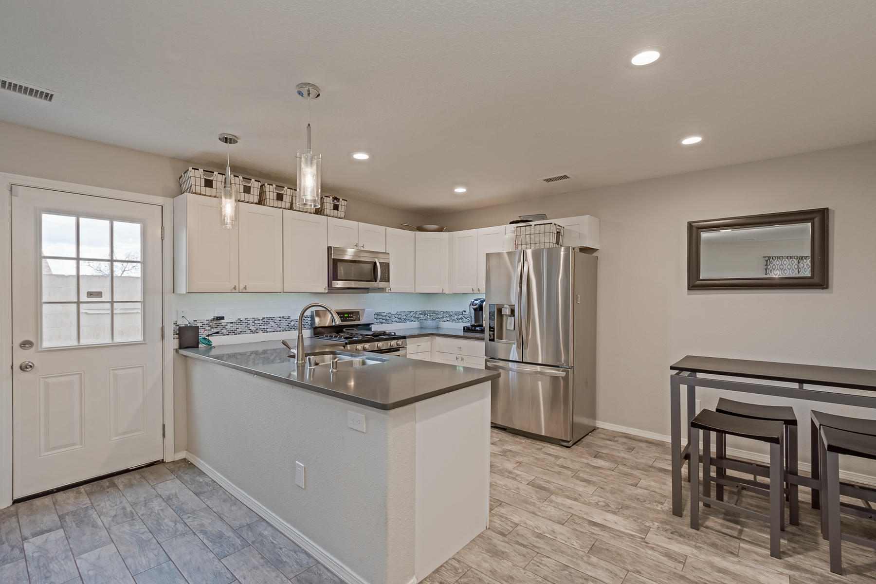 All appliances convey! Solar Panels convey!  Backyard out planters & fountain convey!  Newly installed closet shelving! BEAUTIFUL tile flooring!