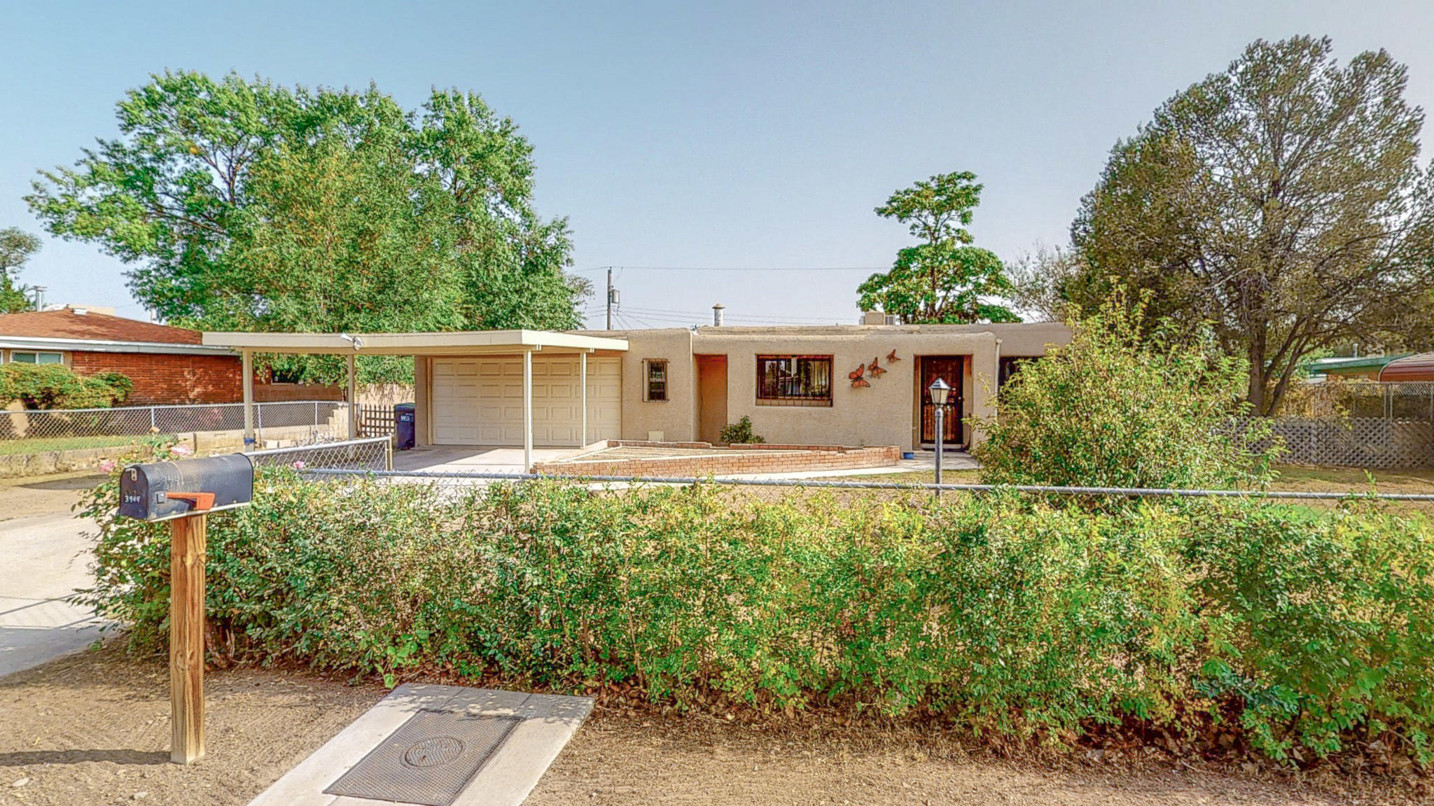 Welcome to your new home in Adobe Acres! Pueblo style home sits on .29 acres with irrigation well.  Remodeled kitchen and bathrooms.  Partial Garage could be changed back to a 2 car garage.  Walking distance to Adobe acres Elementary and park.