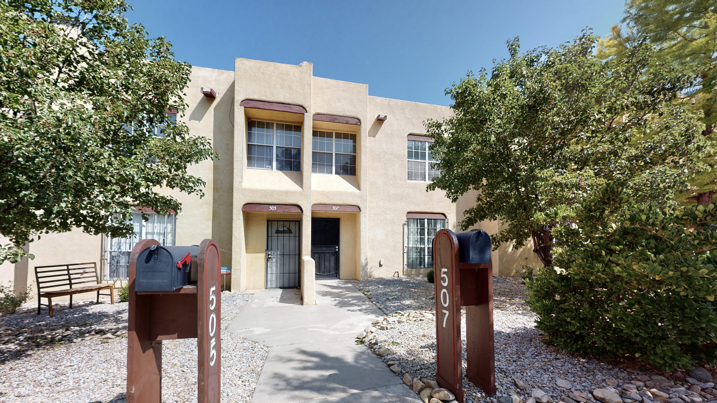 Charming two-story townhome in downtown Albuquerque! The cozy living room features a wood-burning fireplace and oversized window allowing natural light to flow into the home. The beautiful tile downstairs looks like reclaimed wood that will leave your guests in awe! The must-see kitchen is open to the dining room and features a built-in breakfast bar! Take a step outside into the back courtyard area with shade trees and access to the two-car garage! Stackable Washer and dryer stay! Conveniently located in the heart of the city near Lovelace Medical Center, UNM, Downtown, Knob Hill, Old Town, CNM, Museums, Restaurants, Shopping, and freeway access. Take a virtual walkthrough tour!