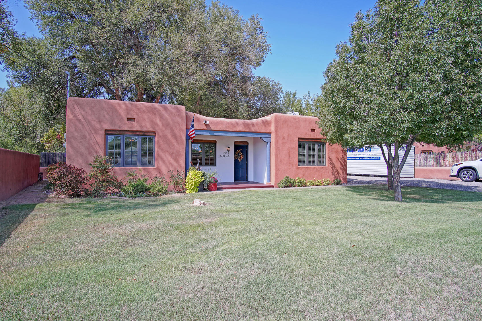 Quintessential Near North Valley Charmer!  Built 1941 +/-  on .33 ac Lot. 2165SF PLUS workshop/gym/studio 198SF.  A gourmet kitchen to die for! Viking Professional 6 burner duel fuel range. Viking refrigerator/hood/ microwave. Bosch dishwasher. Granite counters & custom cherry Shaker style cabinets!   4 bdrms (3 on southside of home & 1 on Northside.)  2  baths. Formal Living room w/ wood burning fireplace & original hardwood floors. Huge family room  w/ brick floors. Separate laundry room.  Gorgeous backyard w/ grass & large trees is fenced. Chicken coop ready for new chicks (w/ fenced yard, too)  Covered Carport  plus plenty of parking behind gate for all your toys.  Tons of parking for friends & family in driveway. TPO roof.  Evap. cooling. Inspections/ Repairs completed. A Must-See!!