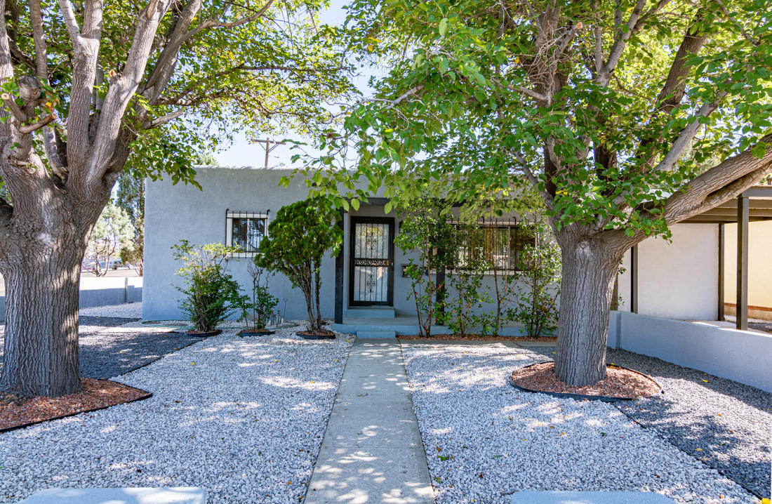 Beautiful updated home in the NE. 4 bed 2 bath with refinished hardwood floors, new tile in bathrooms, fresh paint, stucco has been repainted as well as fresh landscaping,   updated electrical, and refrigerated air. You will not want to miss this opportunity. Call for your showing today