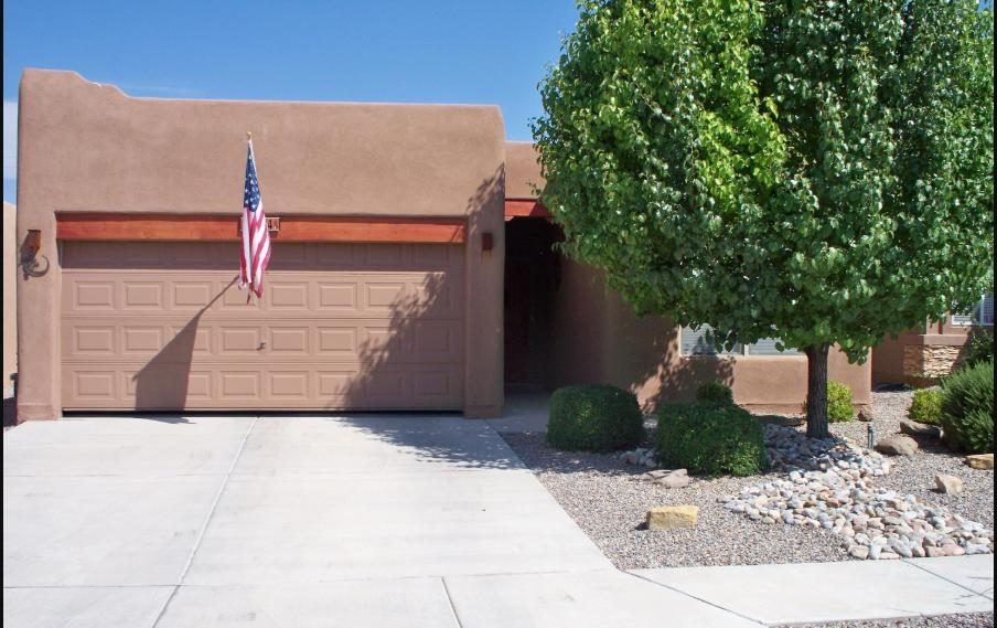 Beautiful single story, open floor plan.Shows pride in ownership. Pueblo style with gas kiva fireplace and tongue and groove ceiling in main living area. Solar tub skylight in laundry room. AC unit, dishwasher, and microwave less than 1 year old.. Easy access to I-40. Great NW location, next to the new Sport Complex. It has gas line outside for the commercial gas grill  that stays.