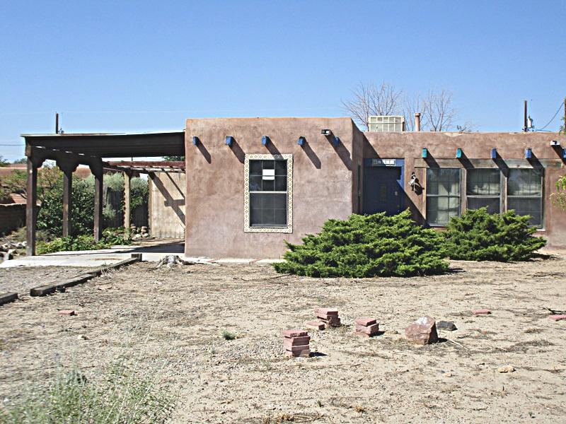 This pueblo style home is nestled in a well established neighborhood on approx. .50 acre.  This home has wood ceiling with beams and brick flooring. This home has lots of character.  Please bring your buyers to see this house. This home is being sold ''As is''