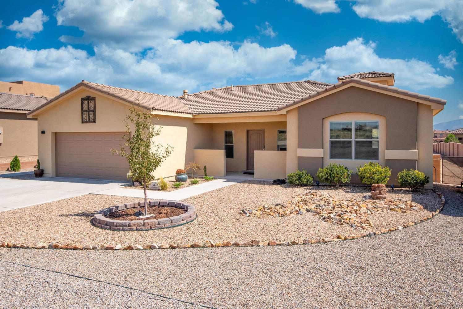Beautiful well maintained 3BR 2BA Spacious open floor plan, kitchen boasts of new stainless appliances, double compartment dish washer, granite countertops, large island, custom Sky Chase skylight,. Enjoy stunning views of the Sandia Mountains from backyard. This and more on 0.50 acre lot!