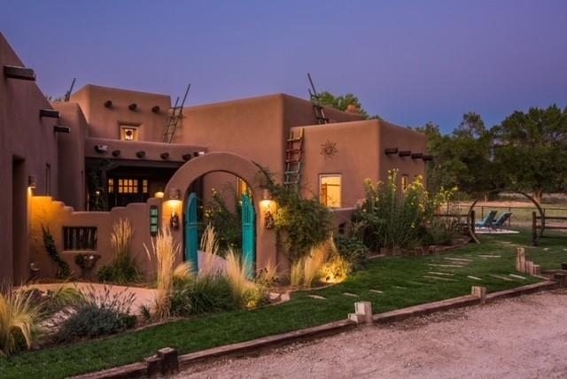 Nestled in the lush green valley along the mighty Rio Grande, this home embodies all that makes NM the Land of Enchantment. 2 years new, the sprawling hacienda provides over 4000sf of awe inspiring interior space PLUS 1028sf Casita. All the finest finishes & iconic SW architecture will have you living in luxury and reveling in time w/loved ones inside and out.  Generous Master Suite is privately located in its own wing & across the garden courtyard from the 3 guest rms. Multiple options for personal & study space. Dream kitchen with alder cabinets, soapstone counters, & high-end appliances, all with a magnificent view of the Bosque. Over 3 acres with 3 pastures for your animals to run free, irrigation ditches, & owned solar.  Spectacular outdoor space with multiple courtyards, patios.