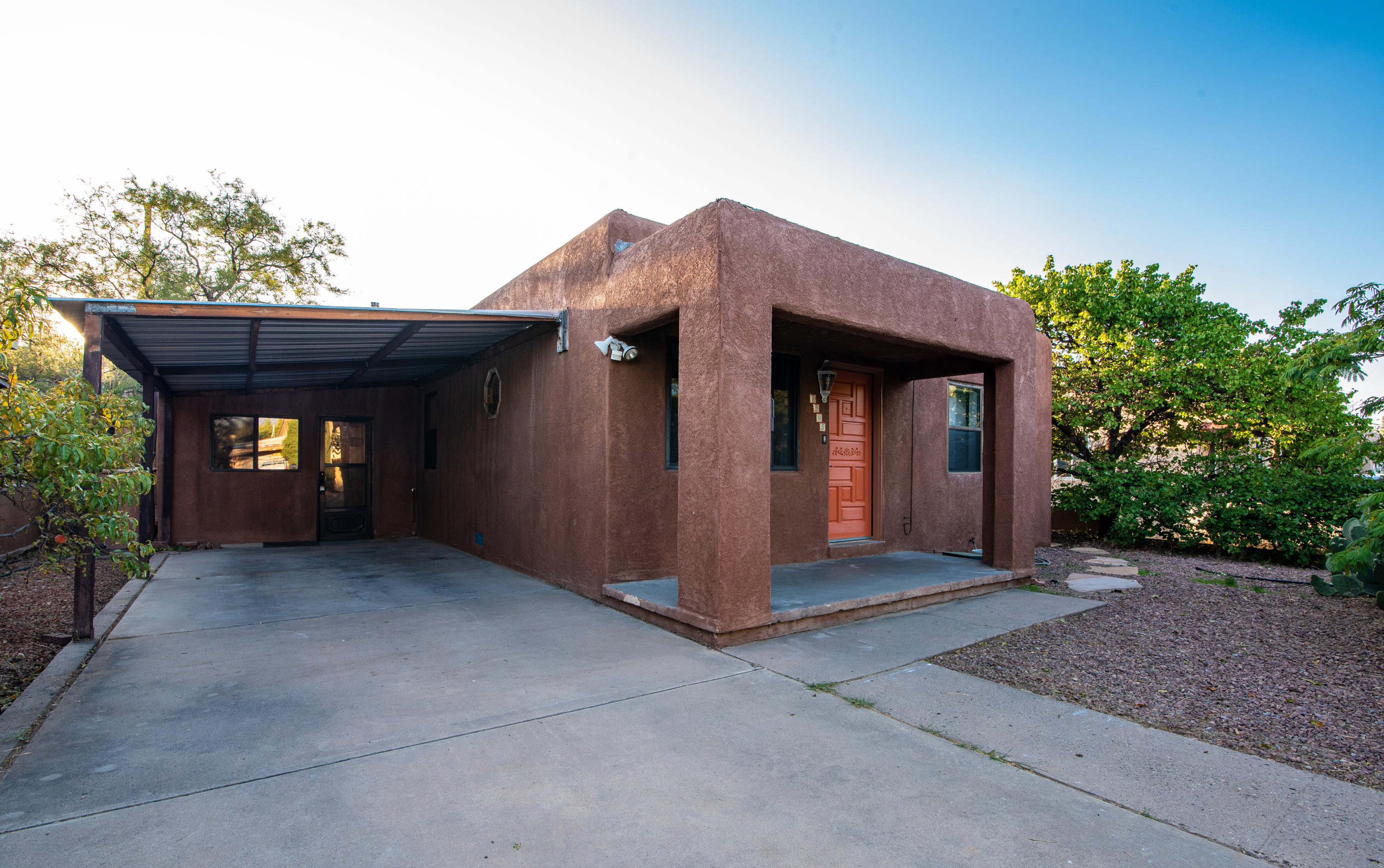 Welcome to 1305 Princeton Dr NE! Located in desirable north UNM area close to all Nob Hill amenities. This home offers hardwood and saltillo tile floors throughout, two completely remodeled bathrooms, a large living room centered around a wood burning stove promising the coziest winter evenings. The private backyard pergola is ready for your patio decorations and enjoyment. Summer evening cookouts will be a new way of life. You'll be within easy pedestrian commutes to restaurants, grocery stores, hospitals and UNM. This would make a great first time home or investment property ready to go for airbnb. The front and back yard are drip system ready for your landscaping designs and gardening wishes. It's just waiting for you to make it your own.