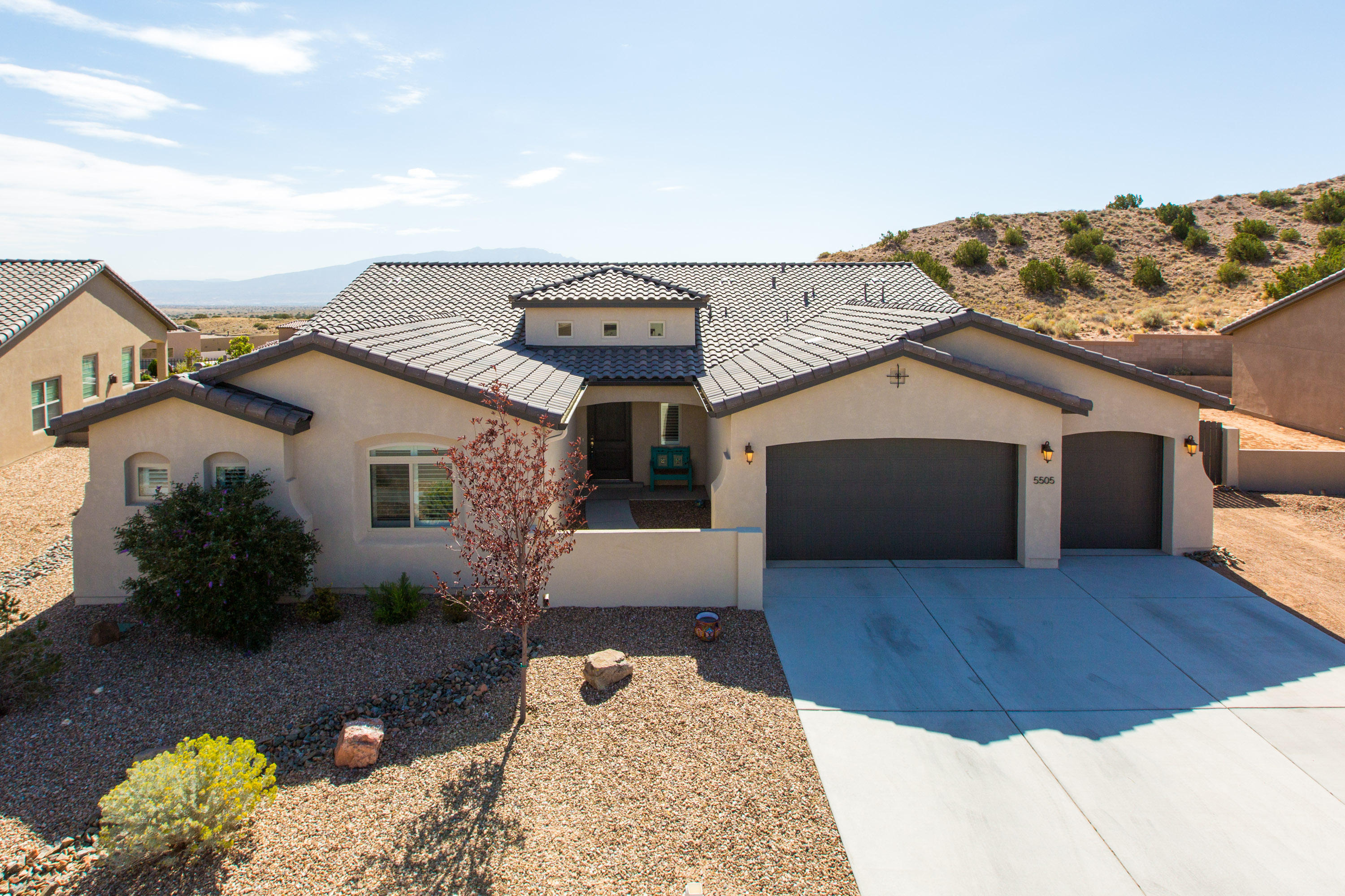 You will be amazed inside and out by this stunning Tiffany open floorplan by Abrazo with Silver Level Green Certification.  Almost new with all the upgrades and custom add-ons already done for you. Just a few include: upgraded appliances (Wolf commercial gas stove), flooring, light fixtures, large stainless farmhouse sink, upgraded cabinets with wine rack, upgraded quartz countertops, master bath has split sinks, dual head walk-in shower, garden tub, pallet wood wall, extra large walk-in closet connected to laundry room, 2 stunning custom barndoors. Backyard fire pit, built in grill, play area, optional custom playhouse, pergola and brick pad area with 220 ready for your hot tub, all professionally landscaped with side yard RV access. Tranquility awaits you in this backyard.