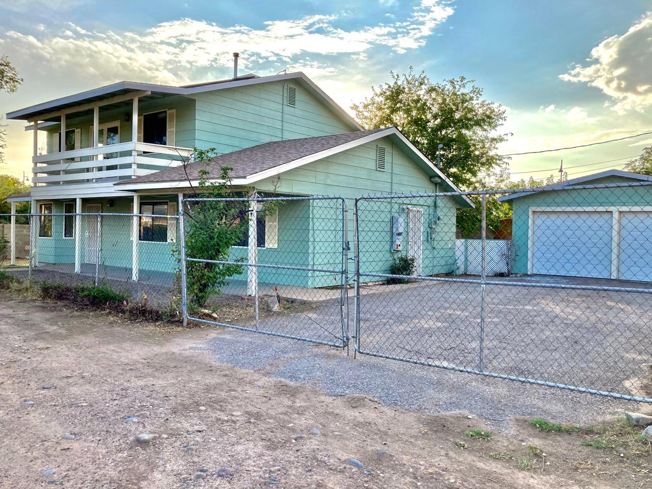 Easy access to I-25, Fenced, 1938 sq. ft., 2 story home with 4 bedrooms (one bedroom is on the first floor), 3 bathrooms, 2+ living spaces, 2 car detached garage.  Sold ''As Is'' without any guarantee or warranty implied. Check bidding deadline/bidder eligibility. Possible insured escrow with FHA Financing. 203K Eligible. HUD Case # 361-435094.