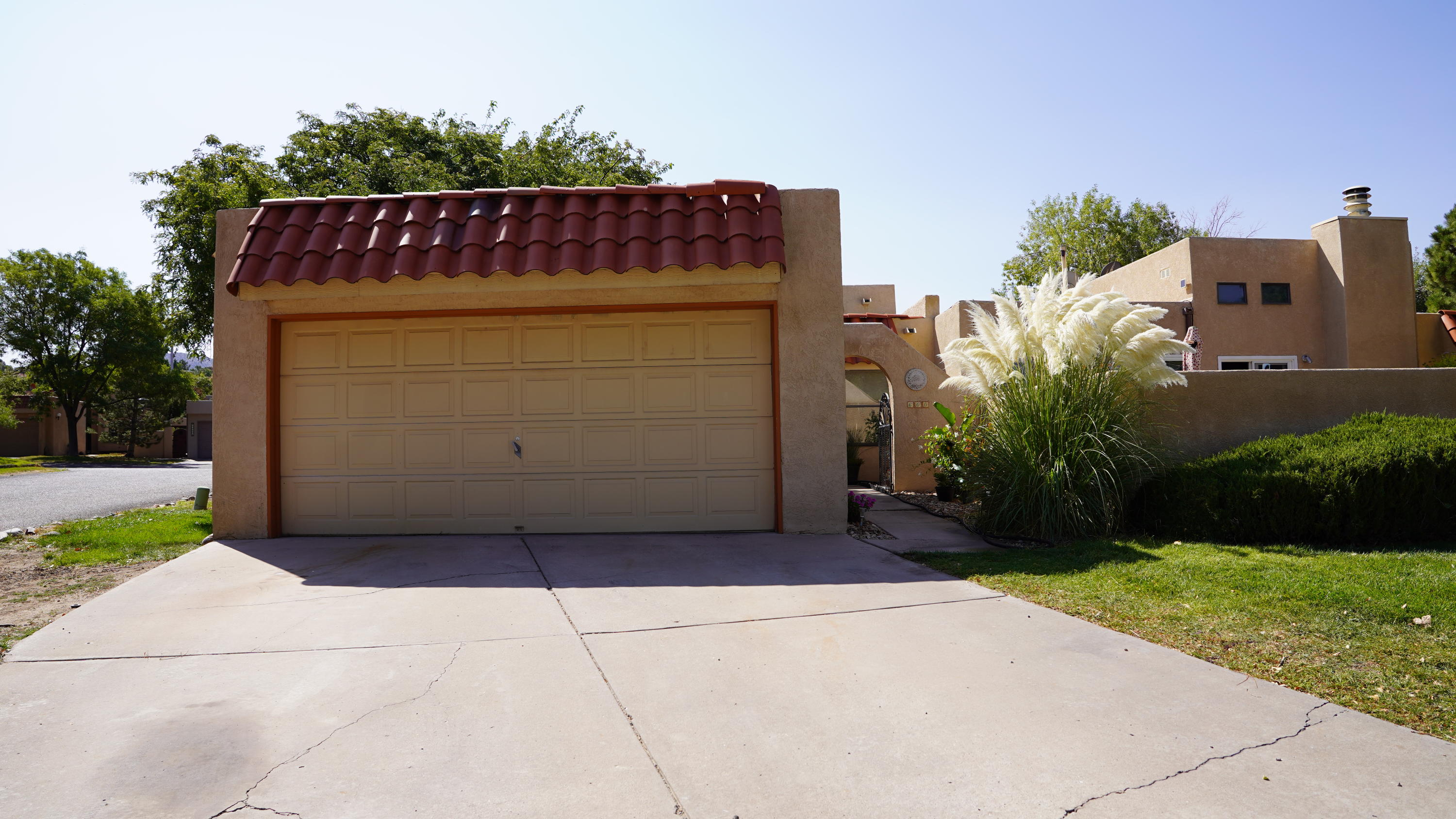 Come and see this  townhome in desirable Hidden Valley. Well maintained with updated kitchen that has stainless steel appliances, granite counter tops, bar top that opens up to your wonderful high ceiling living room that has plenty of natural light, cozy fireplace, with a nice small open aired patio. Master suite is separate from the other two bedrooms and has a upgraded bathroom with snail shower, walk in closet and has access to the back yard. Two secondary bedrooms one with a hideaway bed that will be great for an office. bedroom 3 was turned into a large laundry room, but you can convert it back if needed. Beautiful Private backyard that has covered patio, turf lawn and hot tub that will convey! HOA Covers Water, Trash, Sewer, landscaping, pool and community facilities.