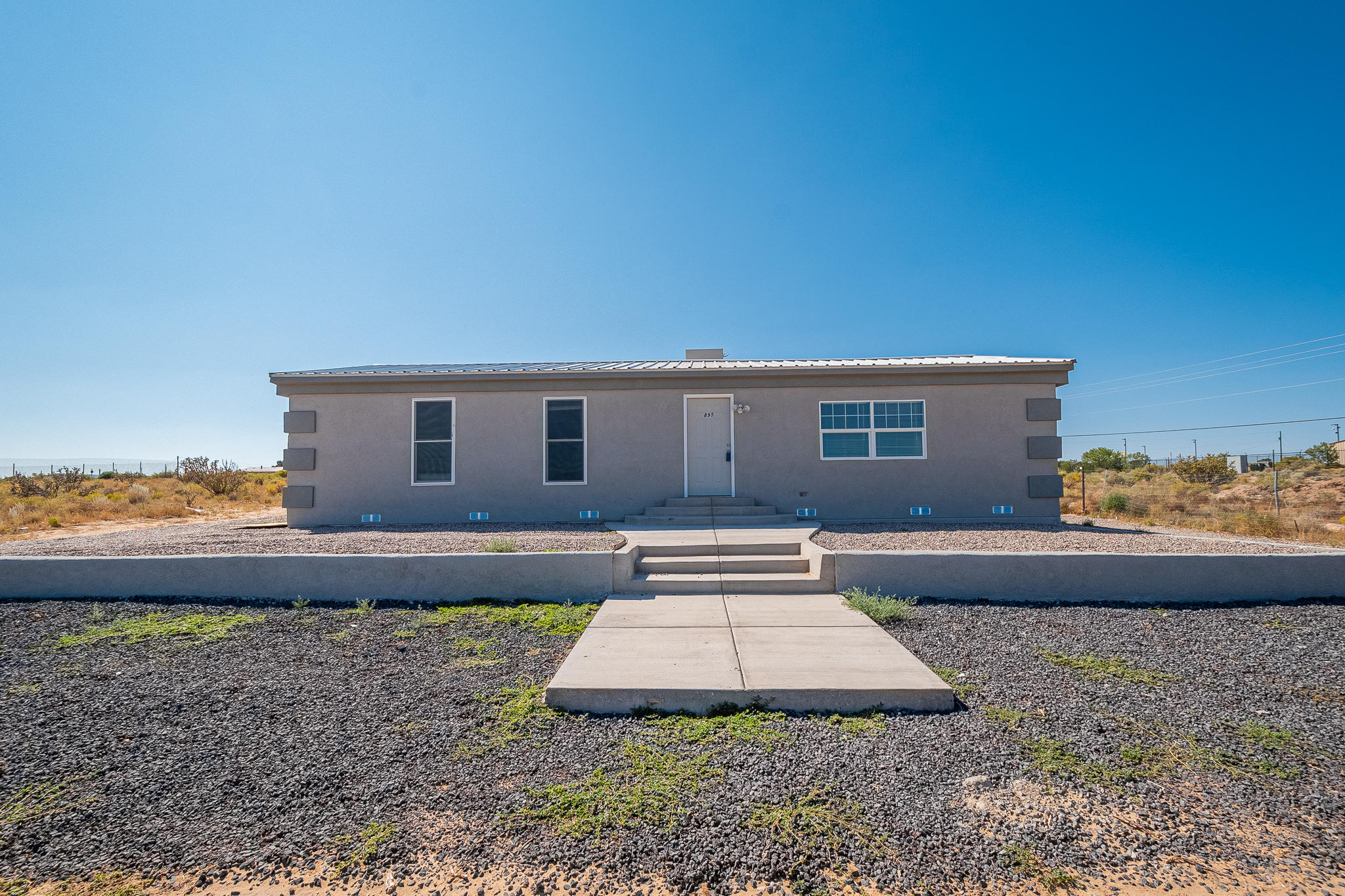 Fully renovated home! New metal roof, laminate flooring, widows and stucco. Here is your chance to buy this home at an affordable price. Come and see this house today!