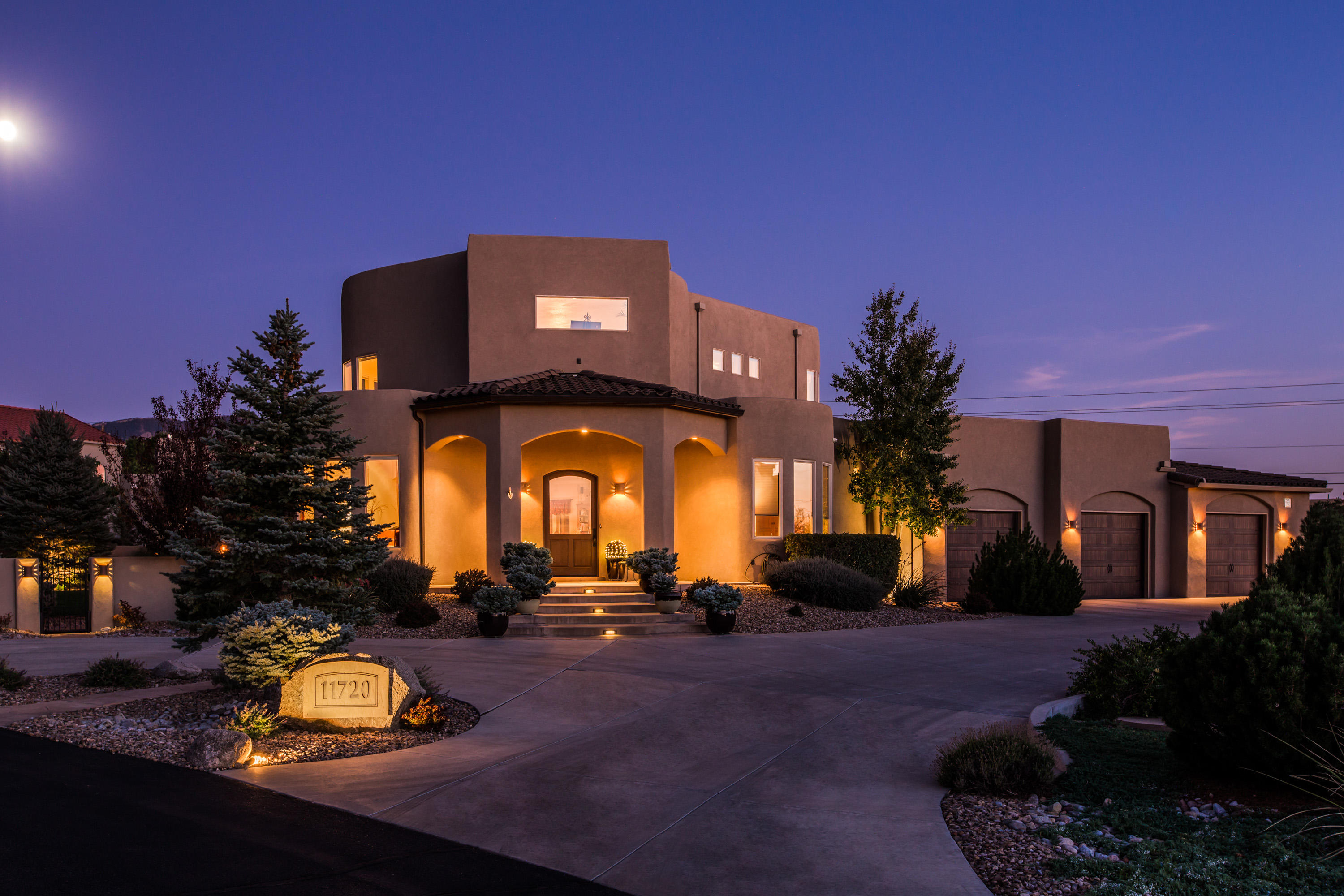 Exquisite Custom Built Masterpiece w/Stunning Views! Impressive architectural details paired with fine appointments throughout, make this home a North Albq Acres 'One of a Kind.'  Enjoy Sandia views from main living area w/custom two-way fireplace shared w/formal dining room & opening to Gourmet Chef's Kitchen boasting gorgeous cabinets/counters; eat at island; Built-in SS appliances; two sep sinks; wine cooler, plus. Upper level has library; exercise & office spaces, Plus: Luxurious Master retreat that includes TWO balconies to enjoy Mtn & City/mesa views! Spa like en suite w/walk-in closet & builtins. Lush landscaped backyard features mtn views from expansive covered patio; builtin firepit; rock waterfall; & hot tub. Garage is car enthusiast's dream. See 'Feature Sheet' for more details.