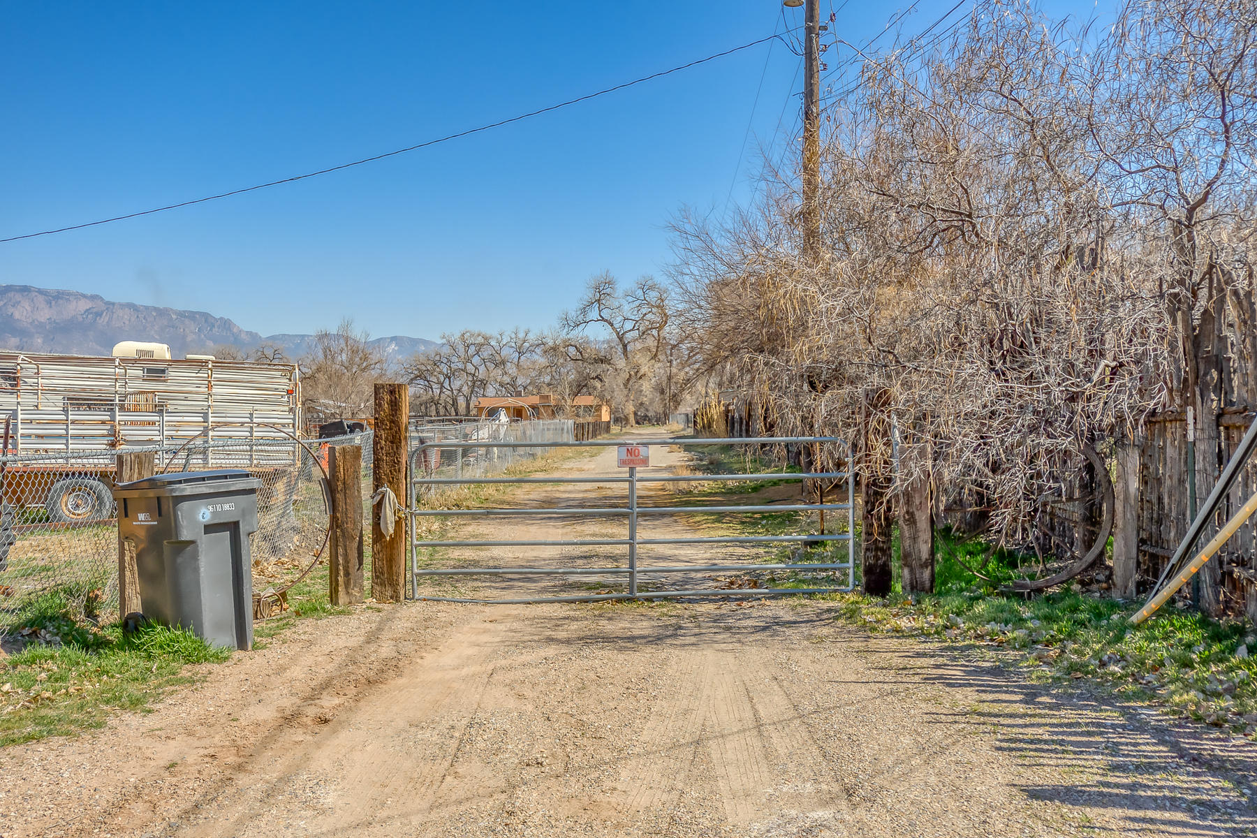 : Special Opportunity in the North Valley! This 2.834 parcel is perfectly located for development! Create your very own private compound or subdivide and build. The property has a 1350 sf house that has some structural issues and will convey '' as is'' Access to endless trails and open space. Nestled under cottonwoods , peace and tranquilityDitch access for irrigation availible