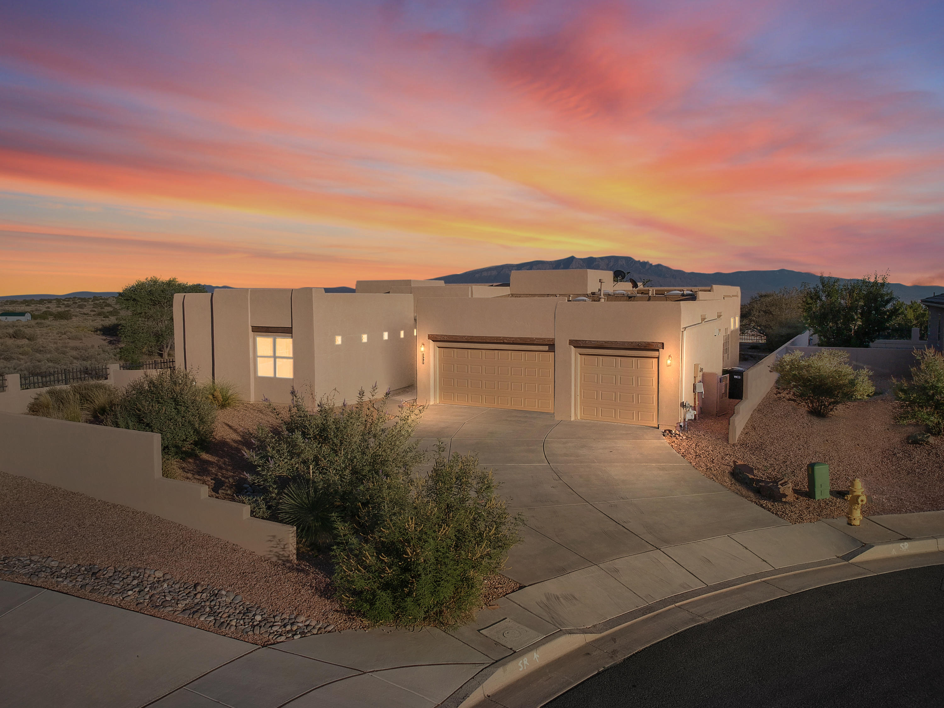 Welcome home to this gorgeous Scott Patrick home in the Vista Manzano development in lovely Mariposa. Let the stunning entryway lead you into the beautiful, large curved living room with picture frame windows showcasing perfect mountain VIEWS and a cozy fireplace for the cool upcoming Fall and Winter days ahead. The spacious kitchen is a cook's delight featuring a large island, eat-in nook, and plenty of cabinetry. Enjoy quaint privacy via the master bedroom courtesy of the split-bedroom design. The fully tiled master bath comes complete with a walk-in closet and jacuzzi tub, and is adjacent to the spacious utility room. All baths are tiled with picturesque southwest tiled motifs. The home boasts soaring ceilings and many skylights making it light, bright, and airy. The incredible backyard
