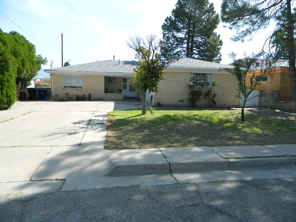 Motivated seller. Great SE location! Convenient to UNM, Medical Complexes and Downtown. Hardwood floors throughout most of the home. Large ''L'' shaped living/Dining area with fireplace. Bright kitchen with loads of storage. Oversized laundry/mud room. Large Family Room addition provides plenty of living area. Home has PV Solar which provides savings in utility bills.