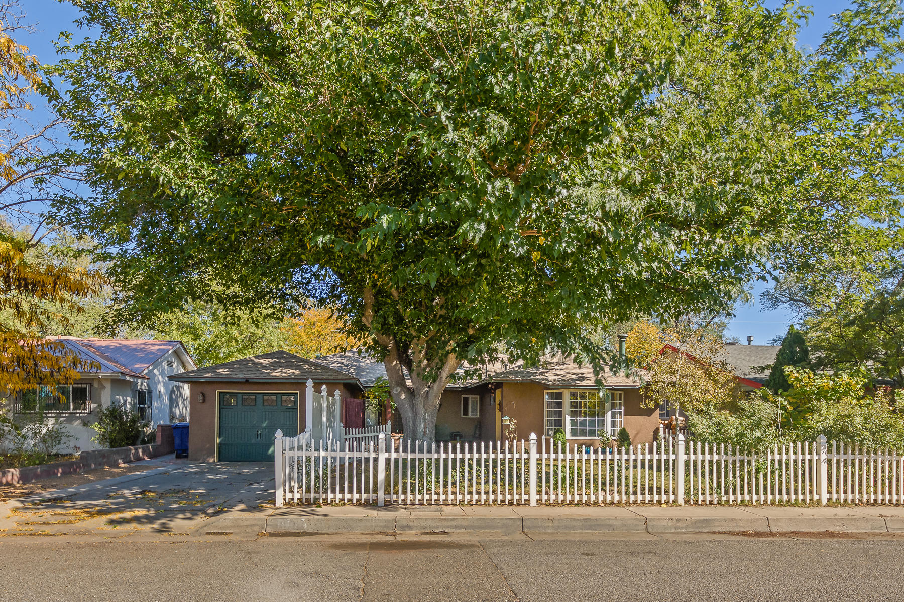 This Nob Hill gem is situated w/direct access to Hidden Park! Enjoy Mid-Century Modern living in this urban oasis with a backdrop of the Sandias. Located within minutes of UNM, Nob Hill, shopping and I-40. The inviting open-concept living & dining area with vaulted TNG pine ceilngs, wood-burning fireplace and large picture frame windows will be sure to satisfy any homeowner's desires. Recently remodeled kitchen with Knotty Alder cabinets, S/S appliances and granite tops. Oak flooring adorns the kichen, dining and other areas. The main owner's suite boasts brick floors, a patio, an attached nursery or office, and an adobe trombe wall. The 2nd master bedroom is nicely sized and has a private entrance, suitable for in-laws or guests. All of this and more inluding a full home inspection