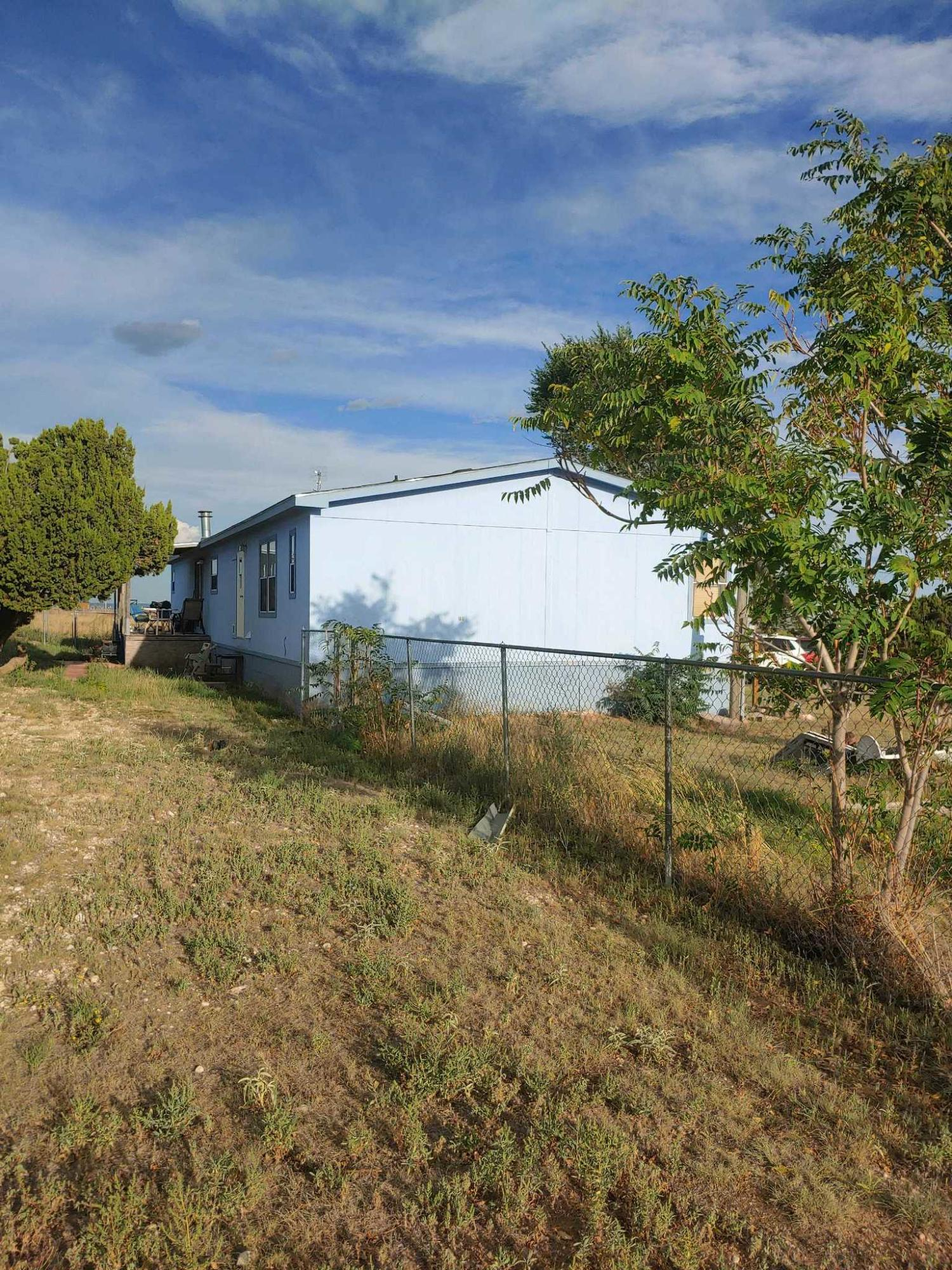 Four-bedroom, 2.5 bath Modular home (2,128sf) @Edgewood .    On 3 Acres 20 min from Albuquerque.   Large workshop/man cave, and a second storage building. Private septic tank,  Natural gas, and community water.  Pride of ownership really shows --   VIEWS!!!VIEWS!!!!VIEWS!!!!