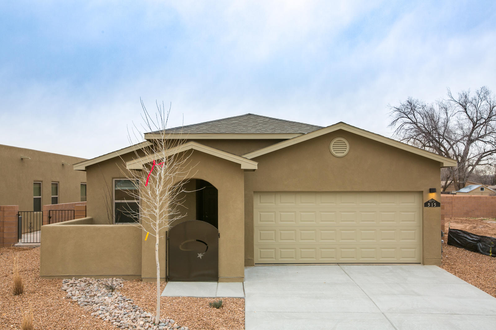 New construction ready Feb/2021. Pics are of model.Actual colors and finishes may vary. Front courtyard is not included. Buy now and make your own color selections. Gated community in the heart of Abq and minutes from the zoo, aquarium, museums, etc. Beautiful luxury bath with separate shower and tub, double sinks, rainhead and walk in closet. Desirable open floor plan with large sliders in the living area opening out to the covered patio. Kitchen has a great island and full Samsung energy efficient appliance package including SxS refrig, stove, dw, microwave all in SS. Washer and dryer are also included in white. Granite kitchen counters. Ltd 10 yr warranty, window coverings, and so much more at this affordable price!