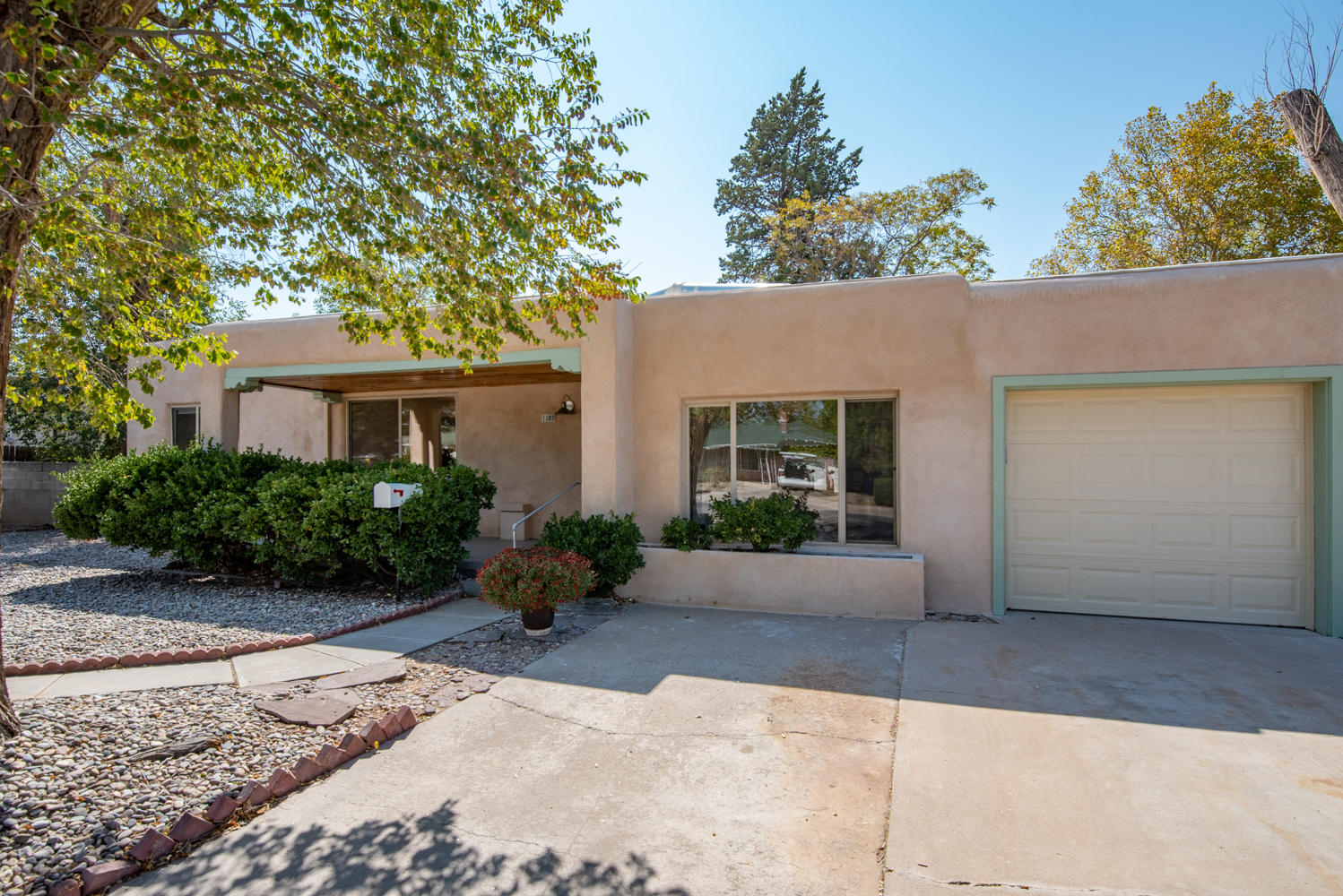 If you have more to do in life than fix up your house, come see this dramatic 3 bedroom, 1 3/4 bath home. Starting from the sprawling front porch step into the gleaming  refinished hardwood floors. Living room and dining room combination with lots of natural light. WOW... New amenities: Central forced air heat  & refrigerated air, total renovated bathrooms and a 3/4 shower was added. Renovate kitchen which includes  new appliances and the washer and dryer conveys. Electrical upgraded to 200 amp service. 3rd bedroom which was total renovated could be used as a den also with a custom wood burning fireplace. Look at the garage it has hollow tile and glass block. It could be used for a studio, home office or hobby room. Run don't walk to see these quality upgrades. Get walking area & park.