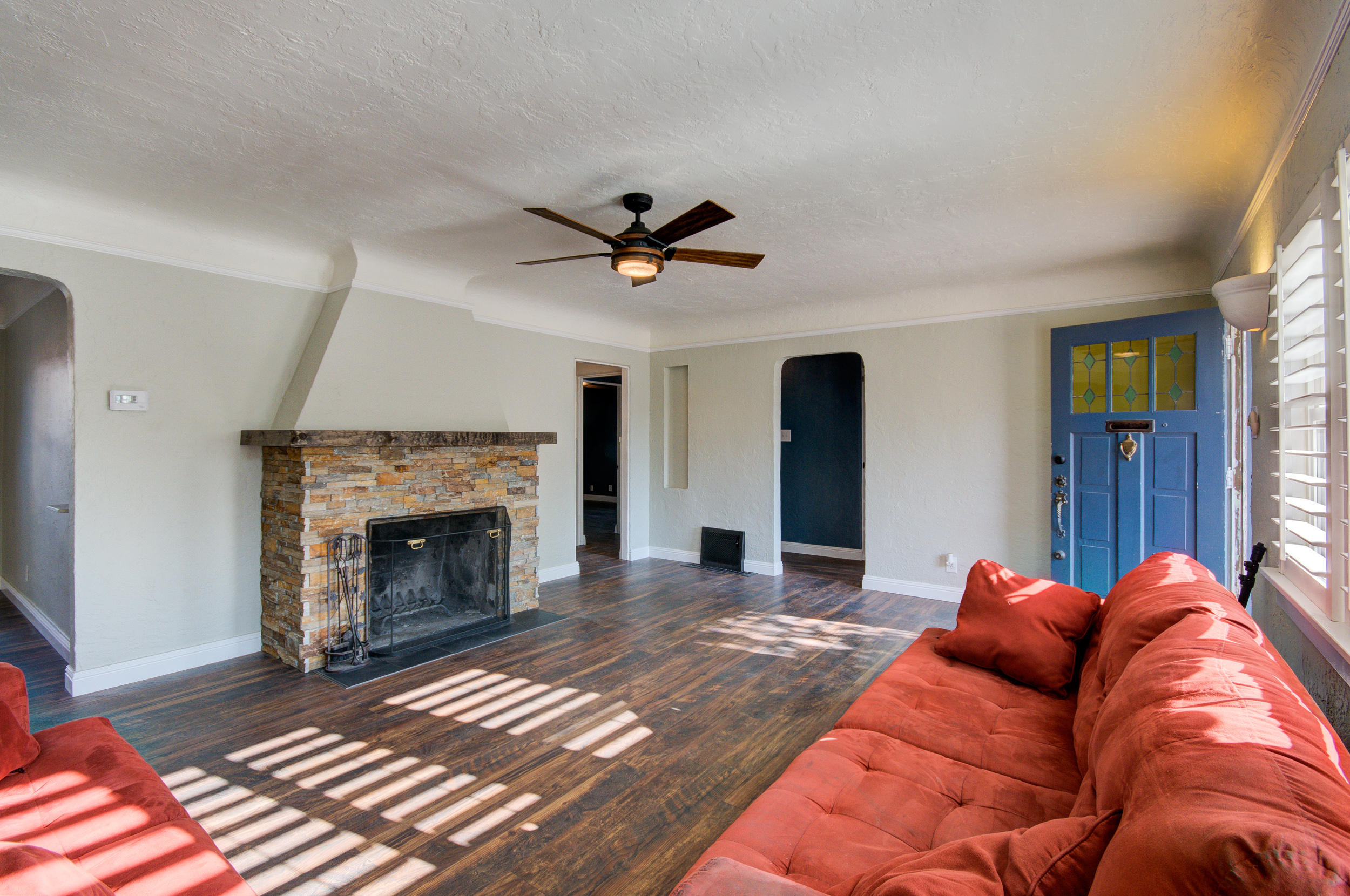 Great location! Charming home with character and modern updates in the Ridgecrest/UNM area. Features a double sided wood burning fireplace with custom stacked stone, cove ceilings, updated bath, new vinyl flooring and paint. Kitchen has updated cabinets and Saltillo tile. Home has a versatile bonus/den room with brick floors and soaring ceiling. Walk-in shower, double vanity with added storage in main bath. New washer/dryer and stove to convey. Large backyard with raised garden beds and space for entertaining. The entire front yard has new landscaping for easy maintenance. Close to parks, shopping, Sandia Labs and Nob Hill.