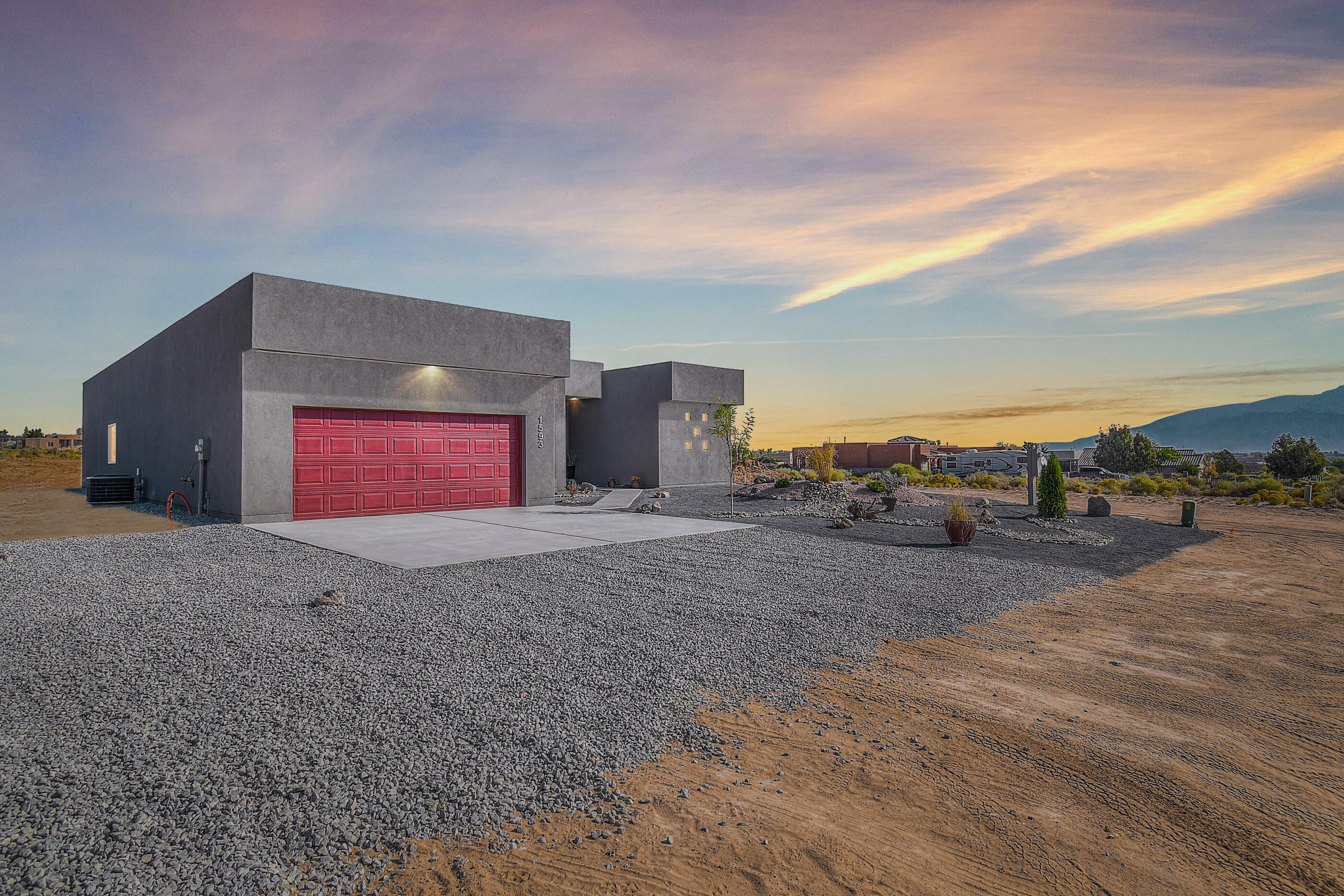 Contemporary multigeneration living!  Beautiful custom 4 bedroom 3 bath.  Featuring two master bedrooms, walk-in closets in every room, natural light in abundance with solar tubes, waterfall granite,  soft close cabinets, Kitchen opens to great room, custom title fireplace, sitting on a large .5 acre lot, side yard access.