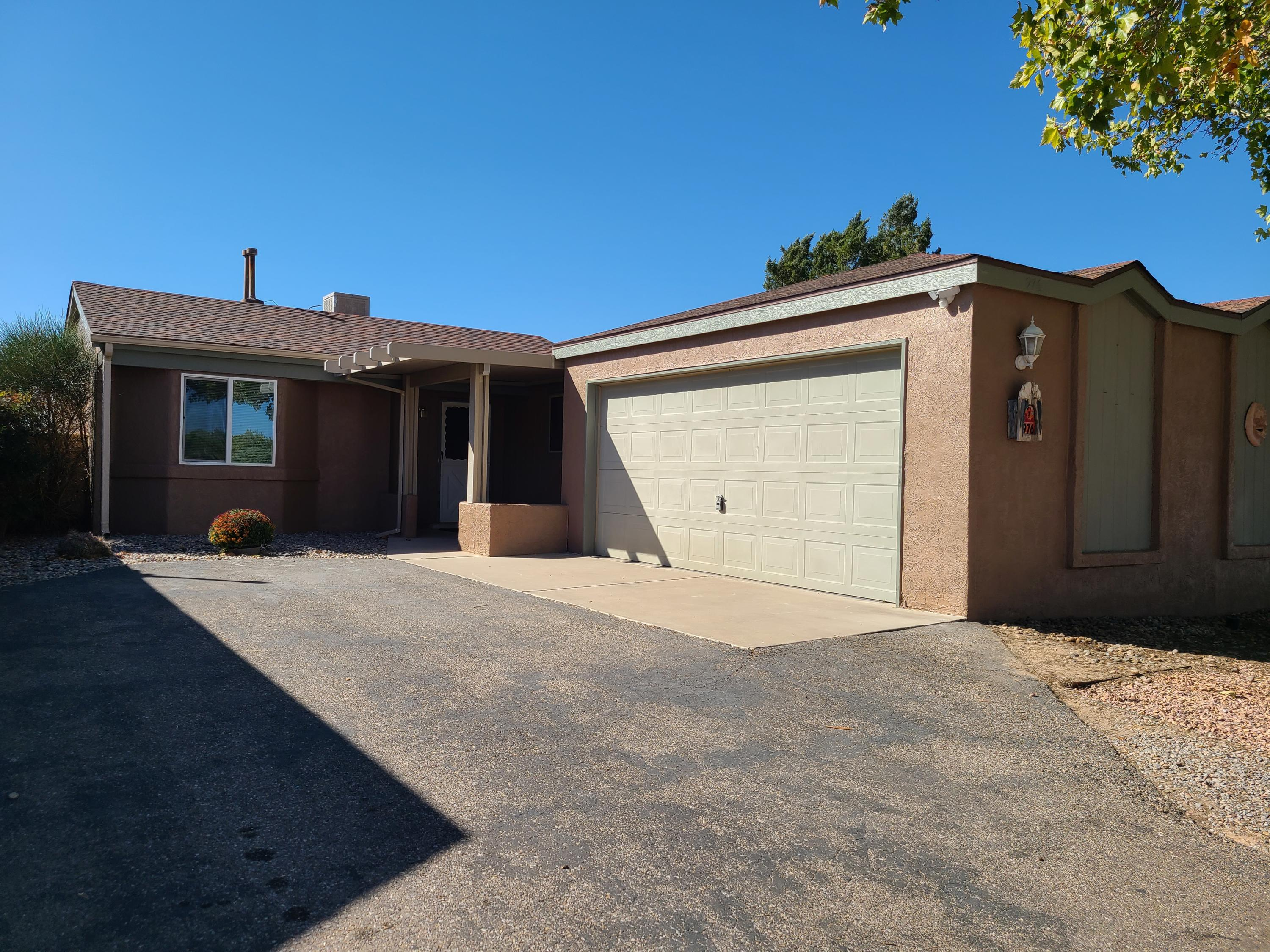 Updated 2 bedroom home in Rio Rancho! Home features new flooring through out as well as paint and updated kitchen. Kitchen has new microwave/range and new oven/stove with marble tile counter tops. Large back yard with covered patio and xeriscape front and back yard. The interior of the home looks brand new!