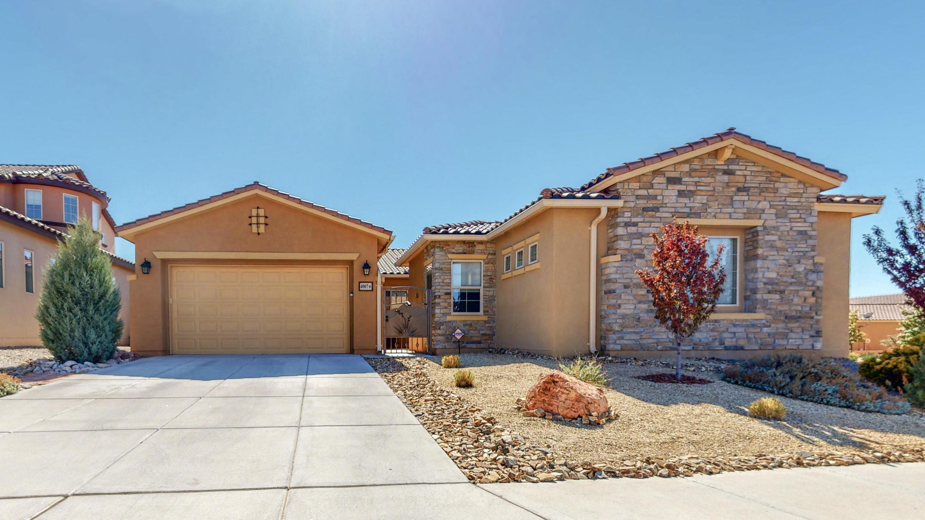 What a beauty! Enjoy natural light filtering through this immaculate 4 bedroom home. Open floor plan with extra living space. Kitchen is spacious with granite countertops and stainless steel appliances. Built-in stove and convention oven. Large master bedroom and bathroom with walk-in closet, double sinks and separate shower and garden tub. Fully landscaped and low-maintenance front and back yard. Don't miss out!