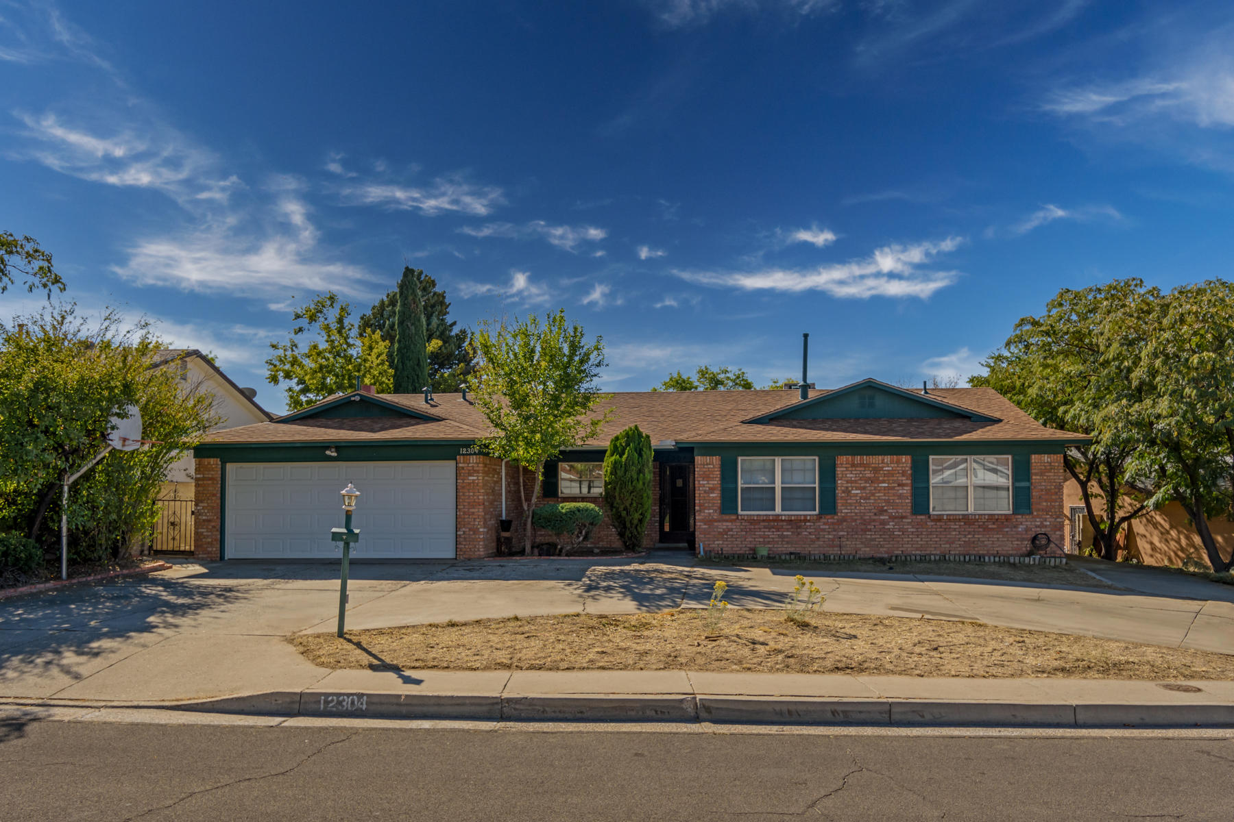 This Holiday Park beautiful brick home just got a brand new roof! It has a circle drive and an RV/boat/additional parking along the side of the home. Single story home with three bedrooms, two baths, and a two car garage. This spacious home offers a living room and also a den with fireplace. Ceiling fans in all bedrooms. Master bedroom has two closets. The backyard is a good size and has a covered patio, mature trees, and a storage shed. This is finally your opportunity to afford a great home in a great area!