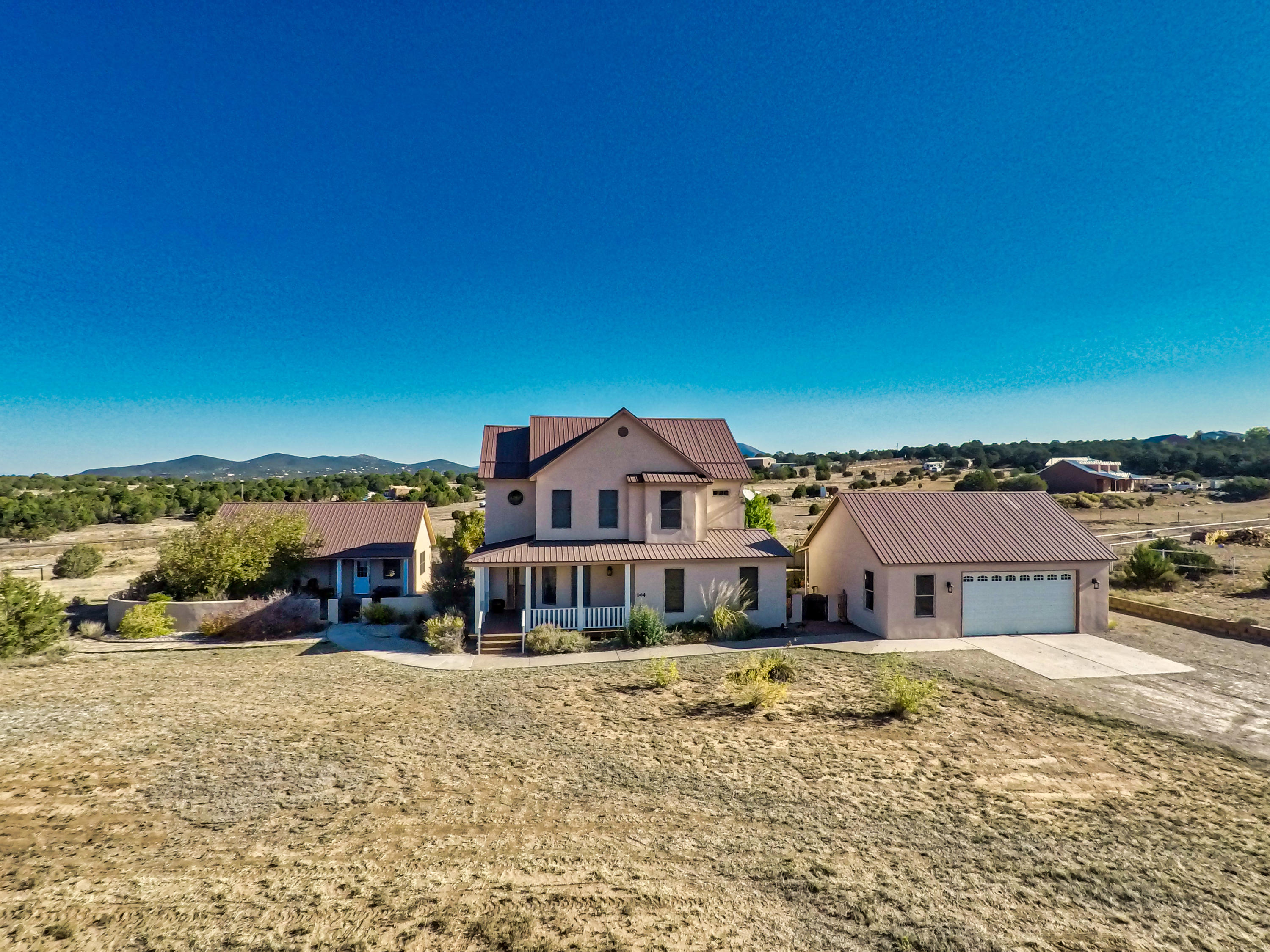 Welcome to Richland Meadows! This beautiful dream home has everything you've been looking for. This custom home has views of the Sandia Mountains right from your own front yard. There is plenty of room to roam on this 2.6 meadowed acres with a nicely landscaped backyard. The formal dining room is ready for family and friend gatherings.The huge 19x19 family room is complete with a nice sized tv that stays with the home. Make your way upstairs where 4 bedrooms and two full baths are there for you when its time to relax. There is a cozy 715 sq. ft. casita with many possibilities with its own bedroom, bath, living room and kitchen area. The finished, heated garage also has a 247 sq. ft addition for all those projects you have planned. Make this home yours before its too late.