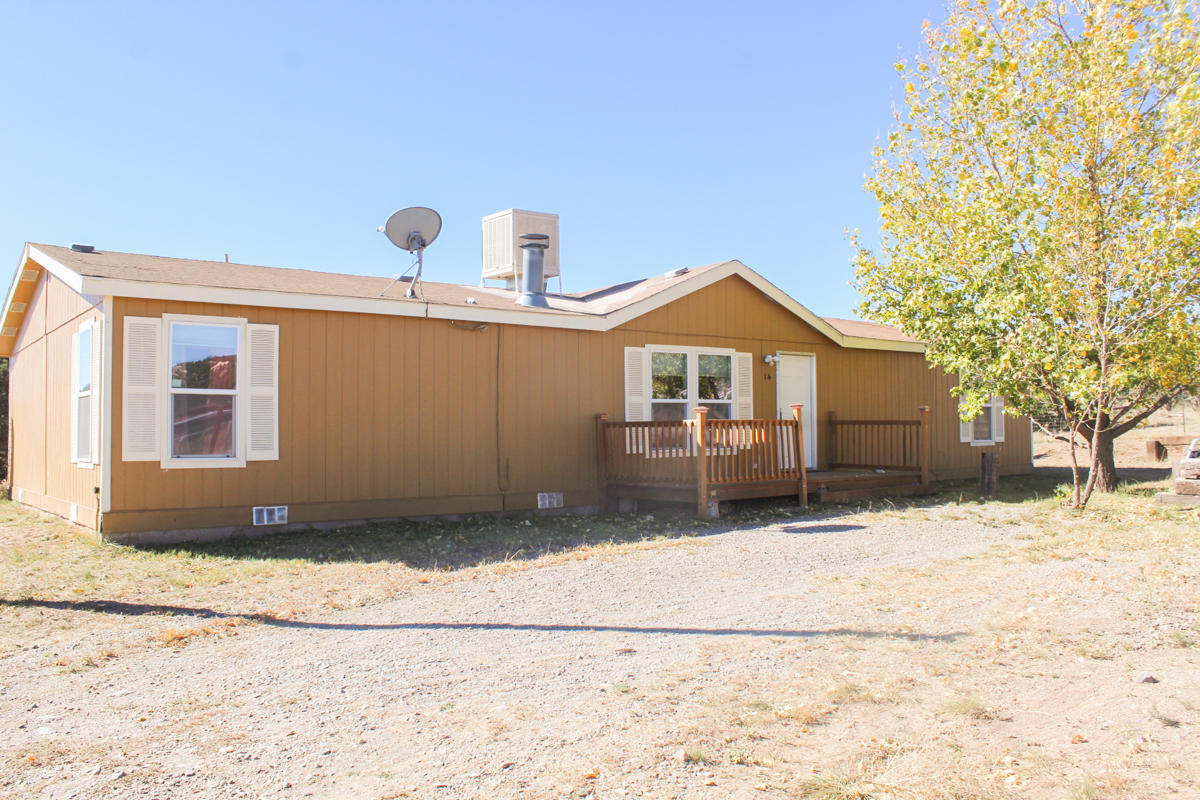 BACK ON THE MARKET.  All inspections done. New metal roof being put on.  A well cared for manufactured home on 2 acres. Just minutes from I-40 and shopping in Edgewood.  Split floorplan with master on one end and 3 other large bedrooms and full bath on the other side. Master has double sinks, garden tub and separate shower. Built-in bookcase in living area, wood burning fireplace that also has an electric insert.  Separate laundry area off the dining room.  Carpet in all rooms but the kitchen, dining,  laundry and bathrooms.  Each bedroom has a walk-in closet. Property is on Entranosa water.  Enjoy the views while sitting on the large deck in the back.  A great place to call home.  Schedule your showing now!