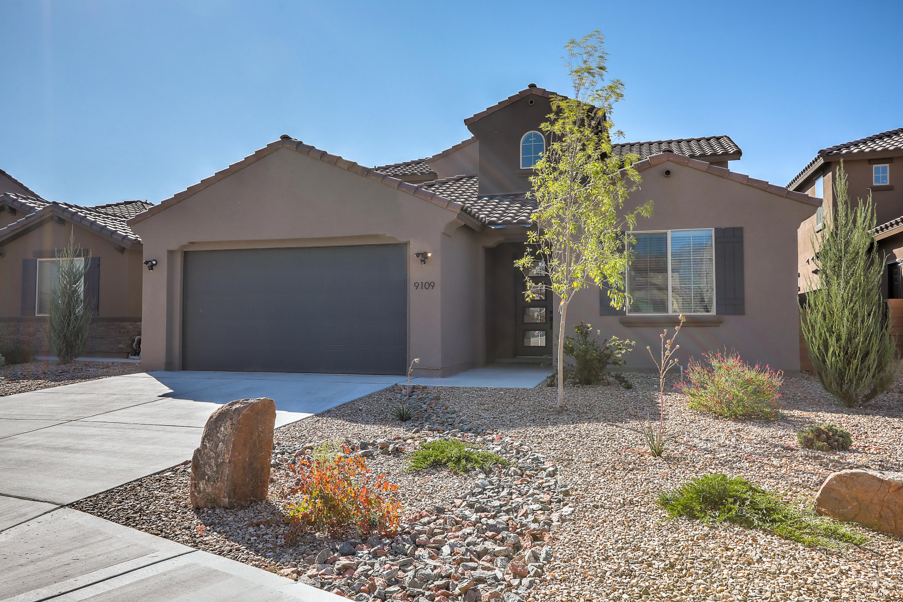 This 1.5 year old custom built Pulte home is nestled in the gated Tierra Serena subdivision. The home has 2 master bedrooms, one upstairs and one downstairs, both with double sinks, large showers, and walk in closets. The home also has 2 living areas, one upstairs and one down. You'll enjoy wonderful features in the kitchen like granite counter tops, Maple cabinets, Whirlpool stainless steel appliances, walk in pantry, breakfast nook, formal dining, and an office area. The backyard is cozy with a covered patio and turf yard. The home itself has refrigerated air, tankless water heater, oversized garage, and Taexx pest defense system. It's a Build Green NM Silver Certified home and has a transferable builders warranty!
