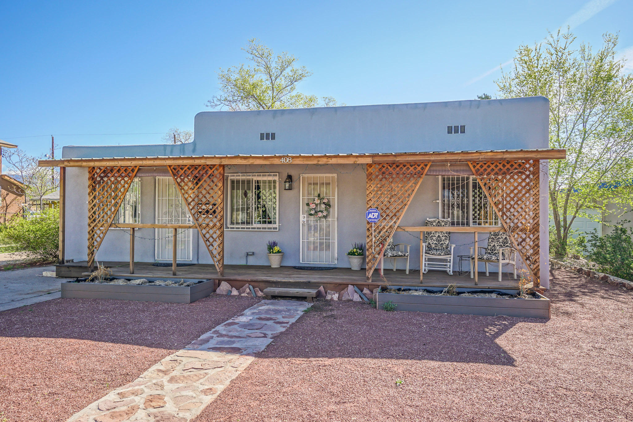 Super close to UNM, Nob Hill, CNM, restaurants, hospitals & Kirtland AFB! Great updates in this home w/separate 2BR/1BA casita! Bandelier Elementary. Main house features 3BR/3BA, refinished wood floors w/on-demand radiant heat, updated kitchen w/island, silestone counters & cherry cabinetry. Updated baths, solid 6-panel doors, 2 fireplaces, 2 living areas, mudroom/laundry w/storage cabinets, updated electrical. Newer roof & exterior stucco, upgraded insulation, security system + custom security windows/doors. Alley access and plenty of driveway and off-street parking. Lovely fenced yard has covered deck, fire pit, mature landscaping. Casita includes newer kitchen/baths/floors, updated plumbing/elec, on-demand H2O & 2 car parking. Marketing pictures and Matterport tour taken in 2019.