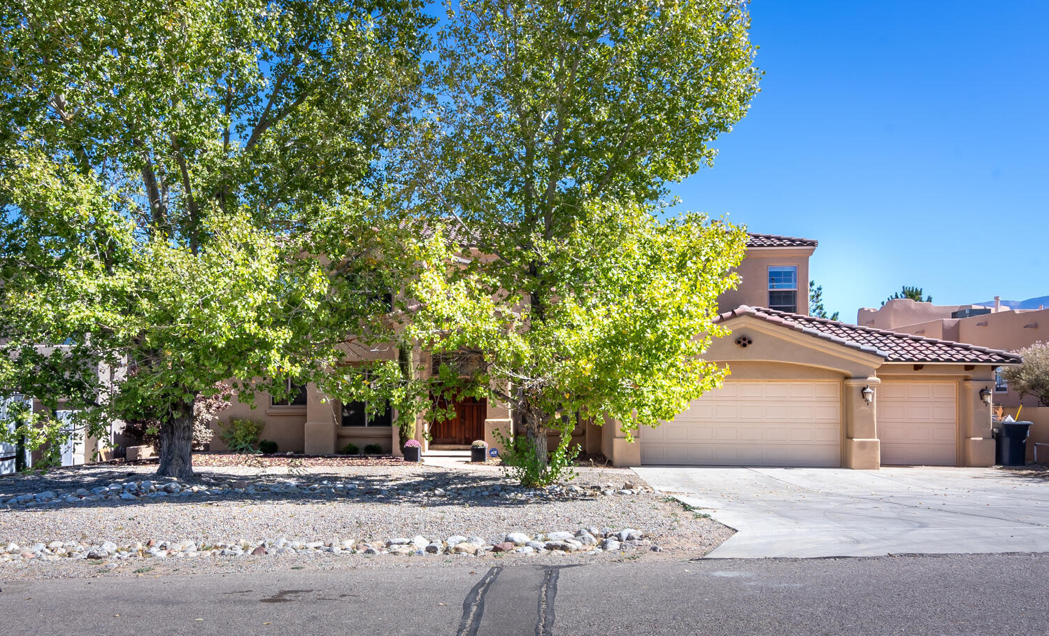 Beautiful custom built 5 bedrm home on a cul-de-sac offers awesome views of the Sandia Mts!  The open floor plan is great for casual living or entertaining family & friends. A private, first floor master bedrm suite has a door to the covered patio & backyard swimming pool. The bright & open kitchen w/ East facing windows has an island, eat in bkfst area, pantry, built-in refrig, stainls appliances, gas cooktop, granite counters & ample storage. The Great Rm w/ fireplace & built-in cabinets, Formal Dining Rm, & Study are conveniently located on the first floor as well. The second floor has 4 bedrms, two full  bathrms & a huge, very open Upstairs Living Area. This casual living area separates the bedrms,  with two bedrms & one bath on either side.  Lovely, very livable home w/ 3 car garage!