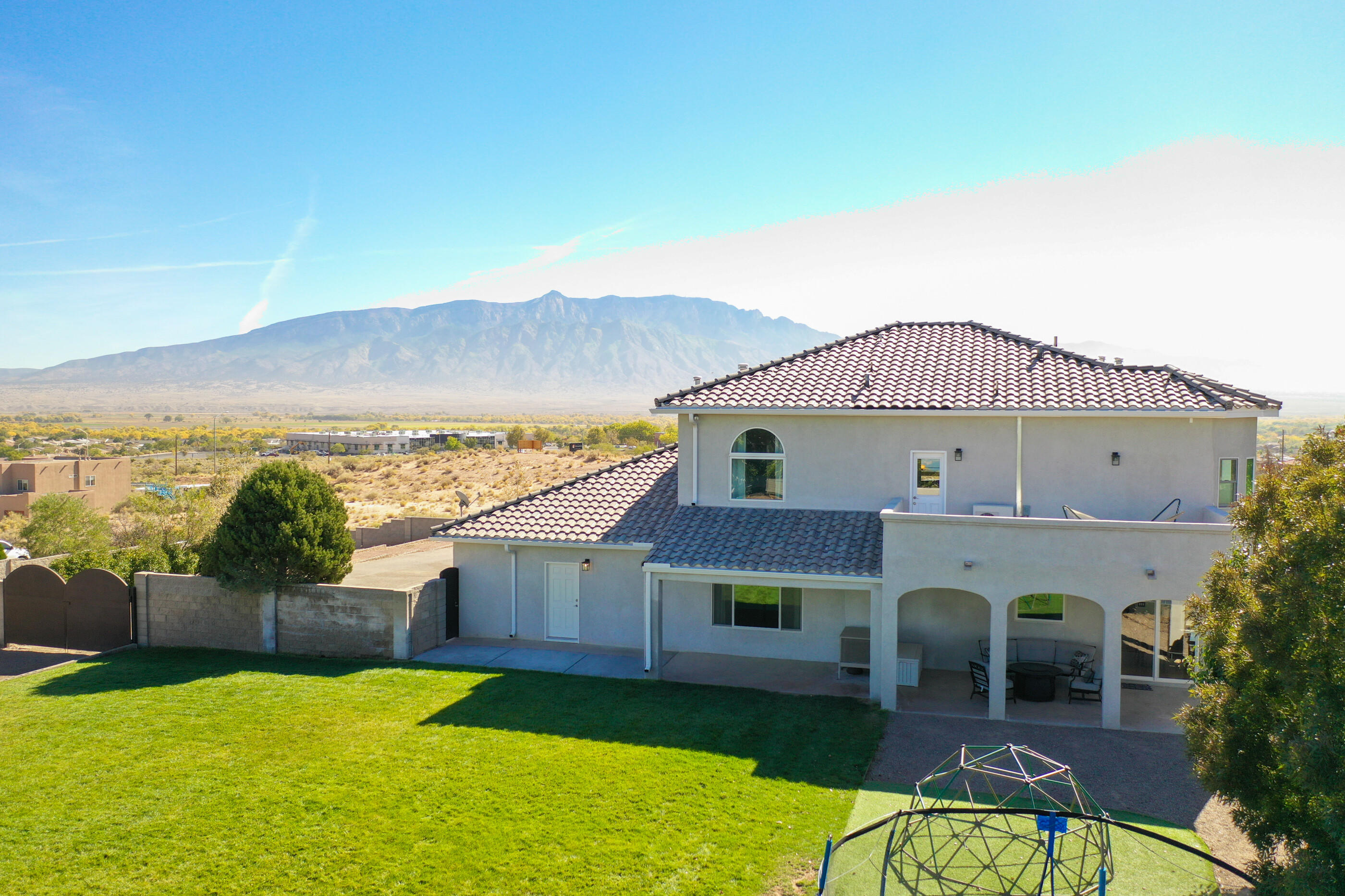 This beautiful, custom build is situated on an acre with stunning panoramic views in every direction. Mature trees surround a private, sanctuary-like backyard fit for a family. The secure dual-entry drive is gated and RV friendly. You are greeted with a two story entry, travertine flooring and grand staircase. The kitchen is appointed with a six burner stove top, double wall ovens, SS appliances, granite and marble backsplash. The owner's suite is luxurious with custom walnut cabinetry, dedicated office space and second floor laundry. The newly renovated home has been freshly painted and has new carpet throughout. This property is an absolute must see.