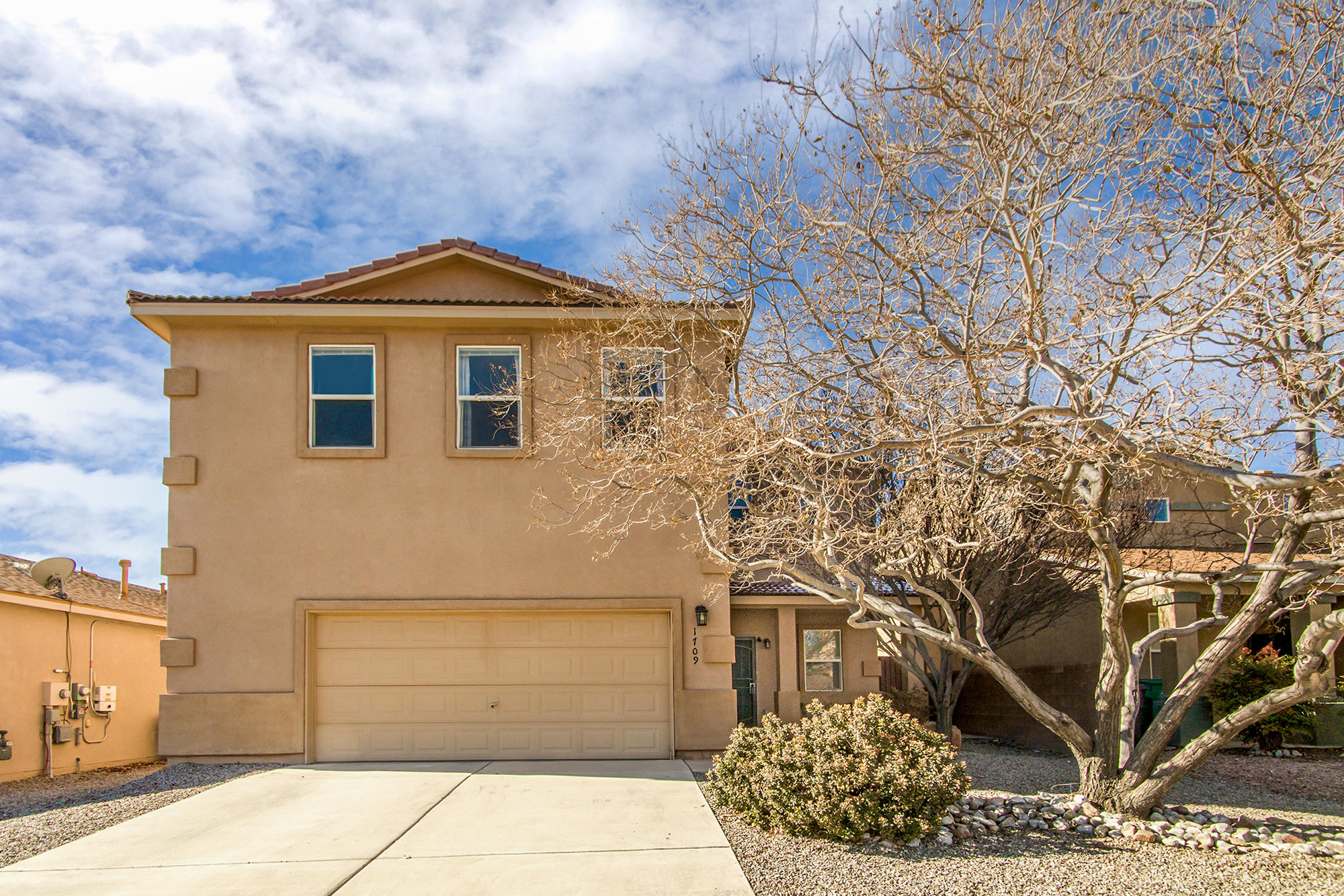 Terrific open floor plan in popular Cabezon neighborhood!  3 large bedrooms plus HUGE loft.  Tons of storage space!  Large kitchen with stainless steel appliances, gas stove, an abundance of cabinet storage and counter preparation space, and a pantry.   Great room has a corner gas fireplace.  Owner's suite is light and bright and boasts a corner gas fireplace, large walk-in closet, double sinks and a soaking tub.  Ceiling fans throughout.   2.5 car garage has extra space and storage racks.  Spacious backyard with mature trees.   Large patio with sun shade.  Fantastic neighborhood with parks, playgrounds, walking trails and city pool.  Convenient to shopping, dining and medical facilities.  Immediate occupancy available!