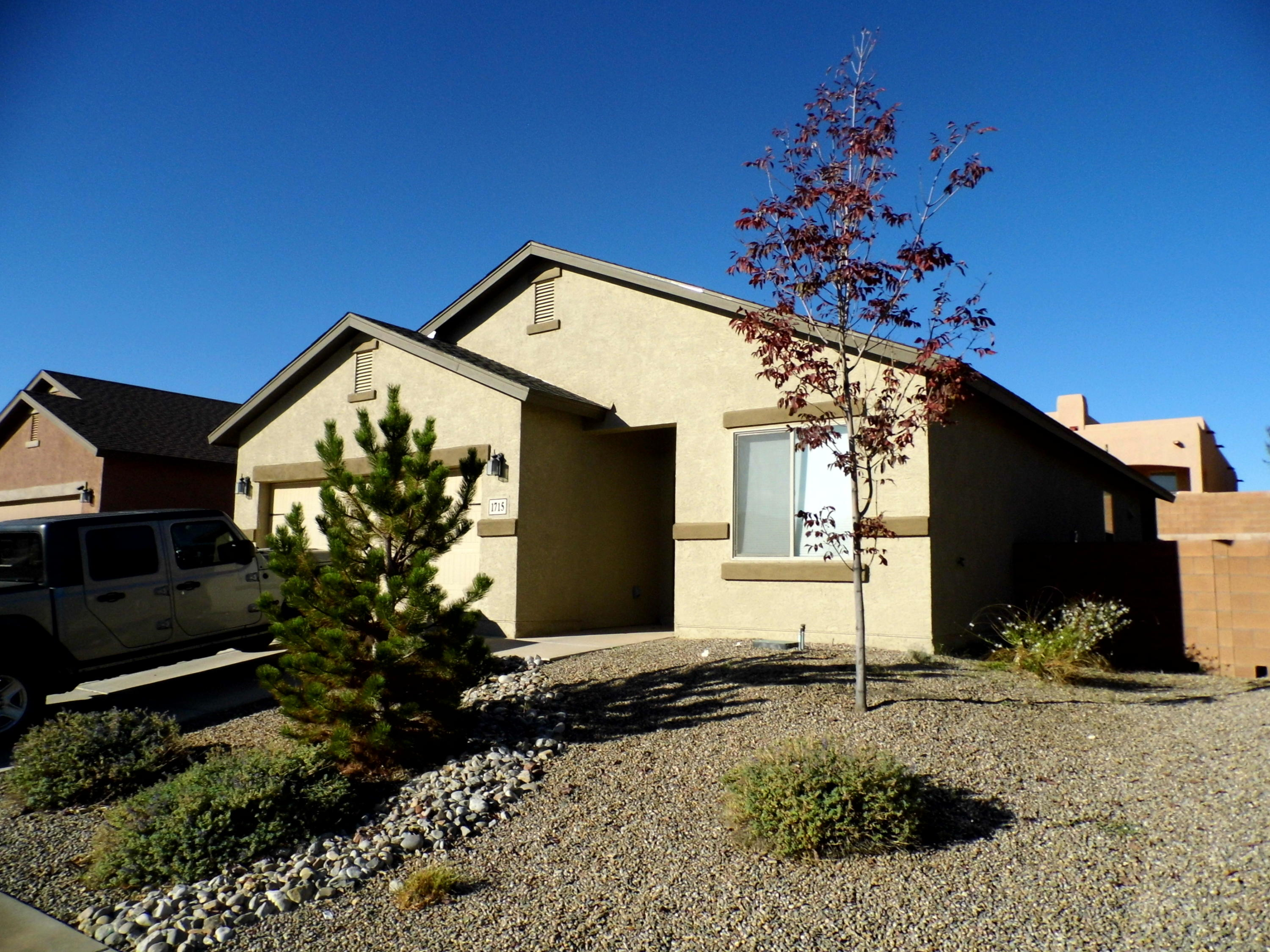 Nice 3 br 1.75 ba.  Great location for access to both RioRancho & Albuquerque. Lamihated flooring in living room plus 1 bedroom. Lots of cabinet space in kitchen with diing area convenient to kitchen.  Good looking counter tops. Home located near to library, city services and much new home construction at higher prices.  Rear yard as multiple fruite trees--apple, cherry and two nectarine.Come see and appreciate this home.