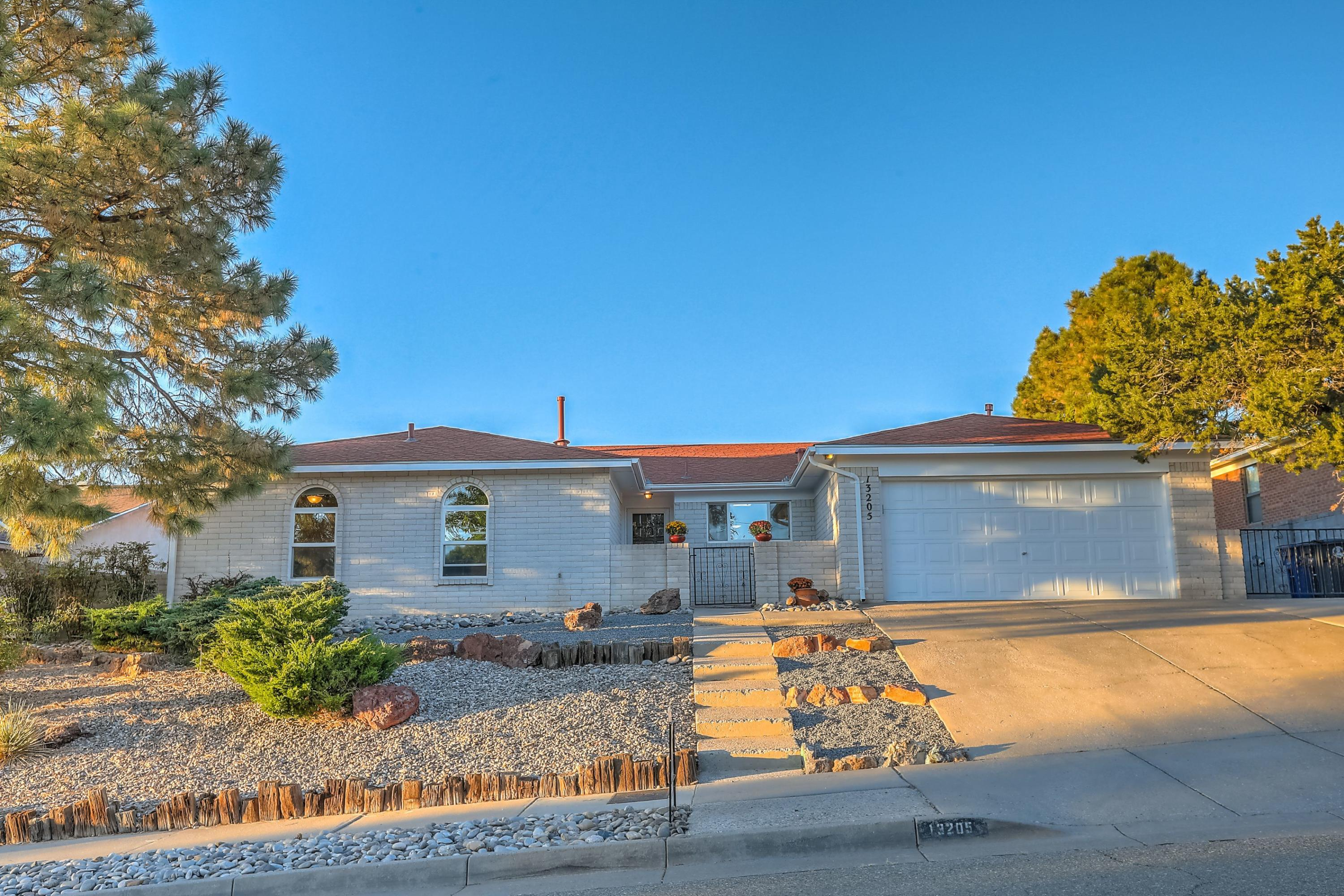 Check out this Beautiful Four Bedroom, White Slump block Ranch, in the foothills of Glenwood Hills! Numerous recent updates. Light and Bright with Custom Rock Face Wood Burning Fireplace with open Dining Room and Family Room. Side yard access and big Back Yard! Within walking distance to Sandia National Forrest area and Park.
